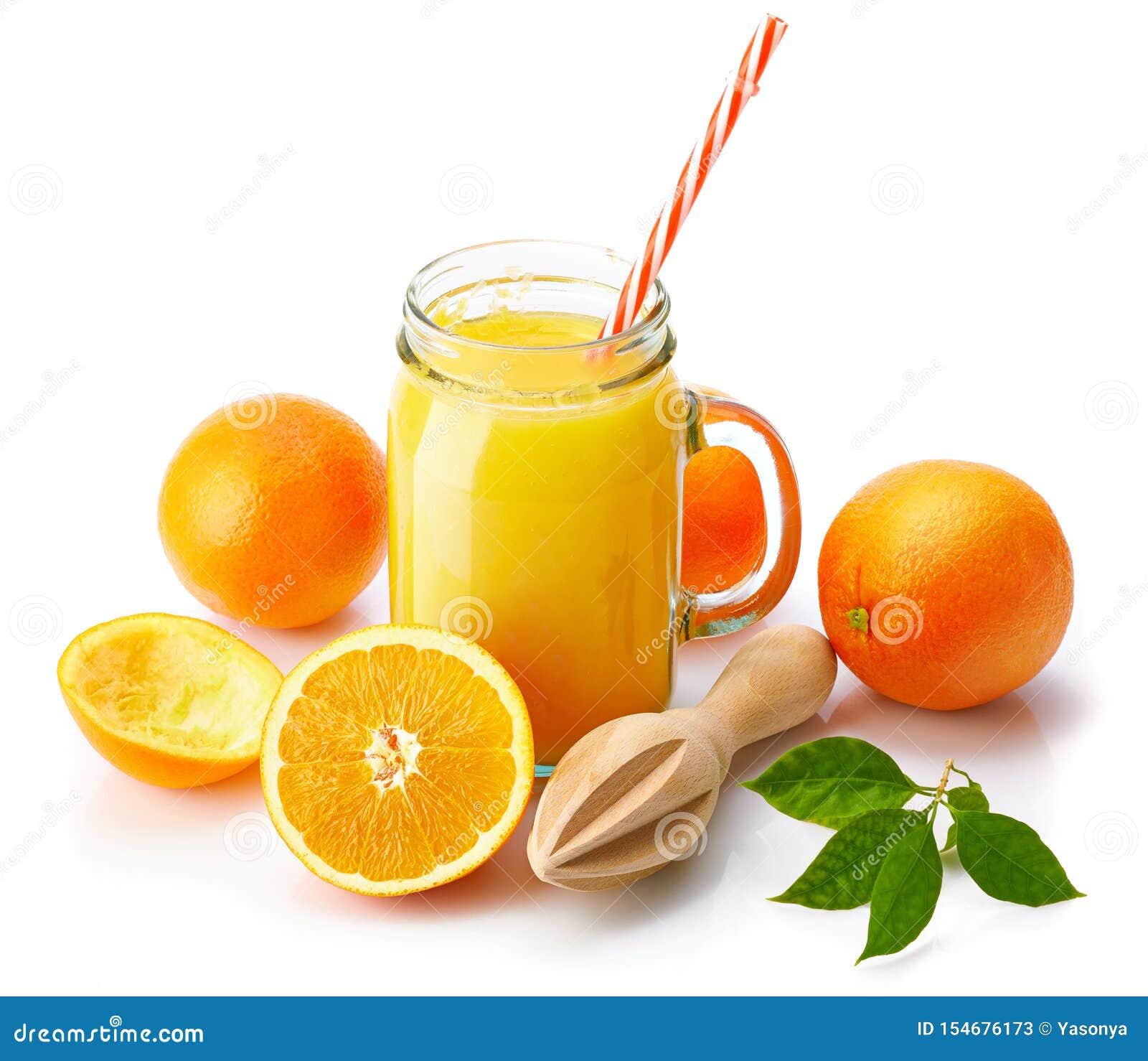 Jus d orange frais avec le fruit et le vert