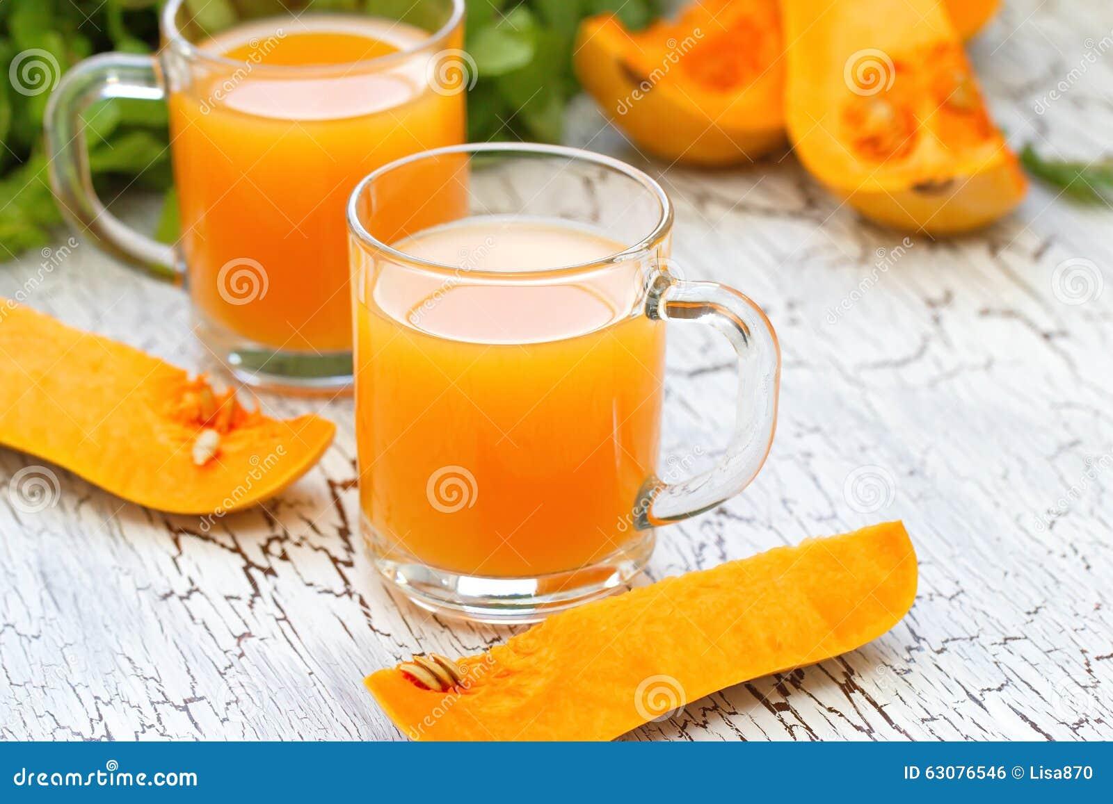 Download Jus frais de potiron photo stock. Image du glace, orange - 63076546