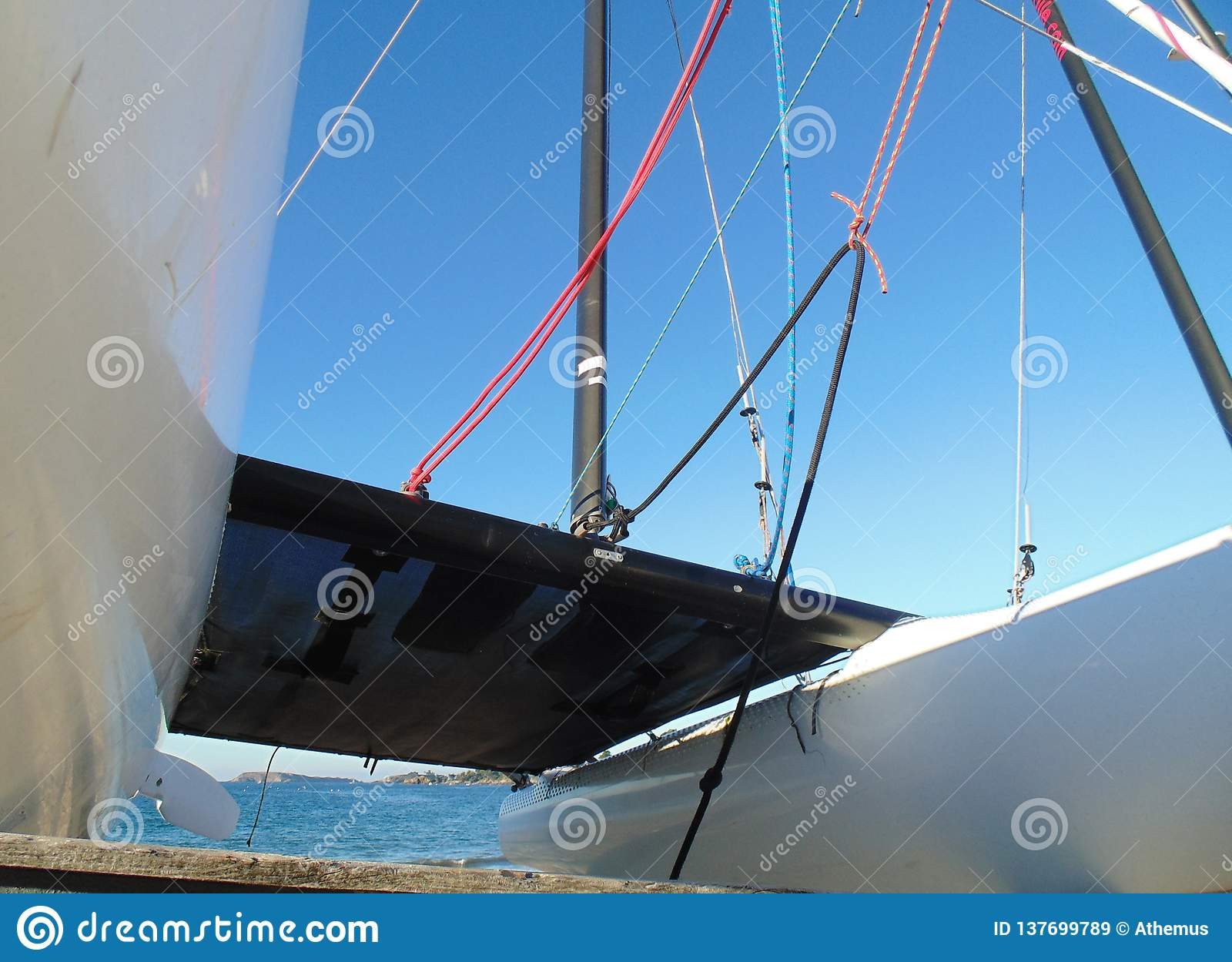 Just in front of the catamaran