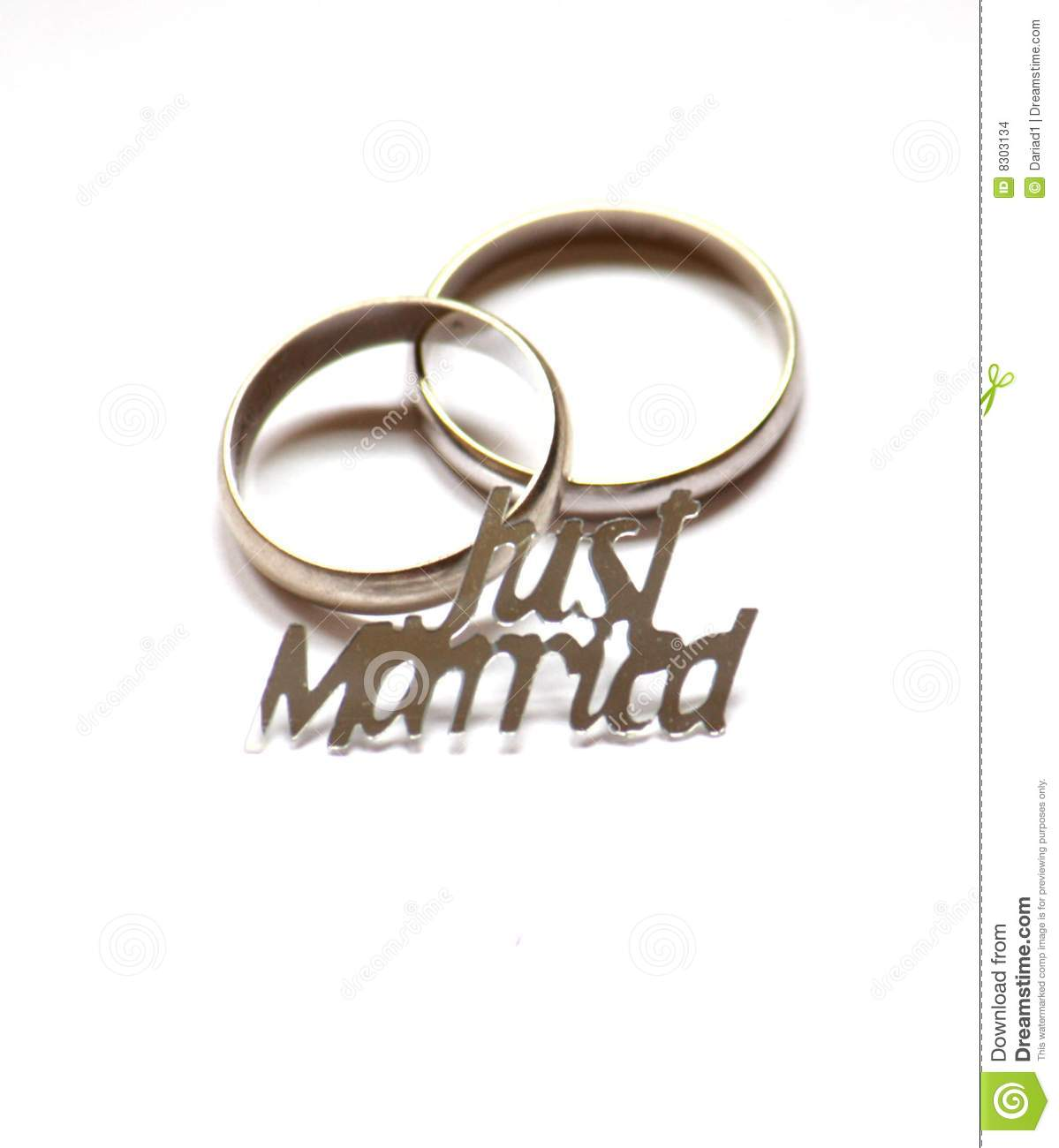 Close up of two rings and a just married sign.