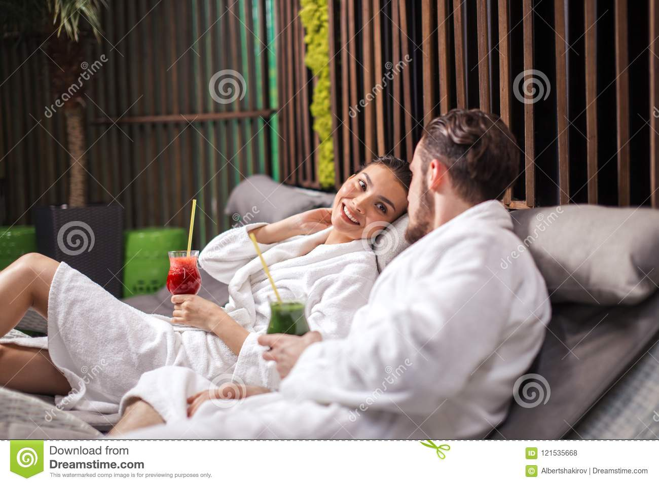 Just married couple enjoying spa wellness treatments indoors