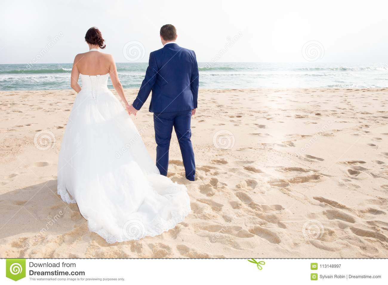 Just Married Couple Walk On Fence By The Beach Bride And Groom