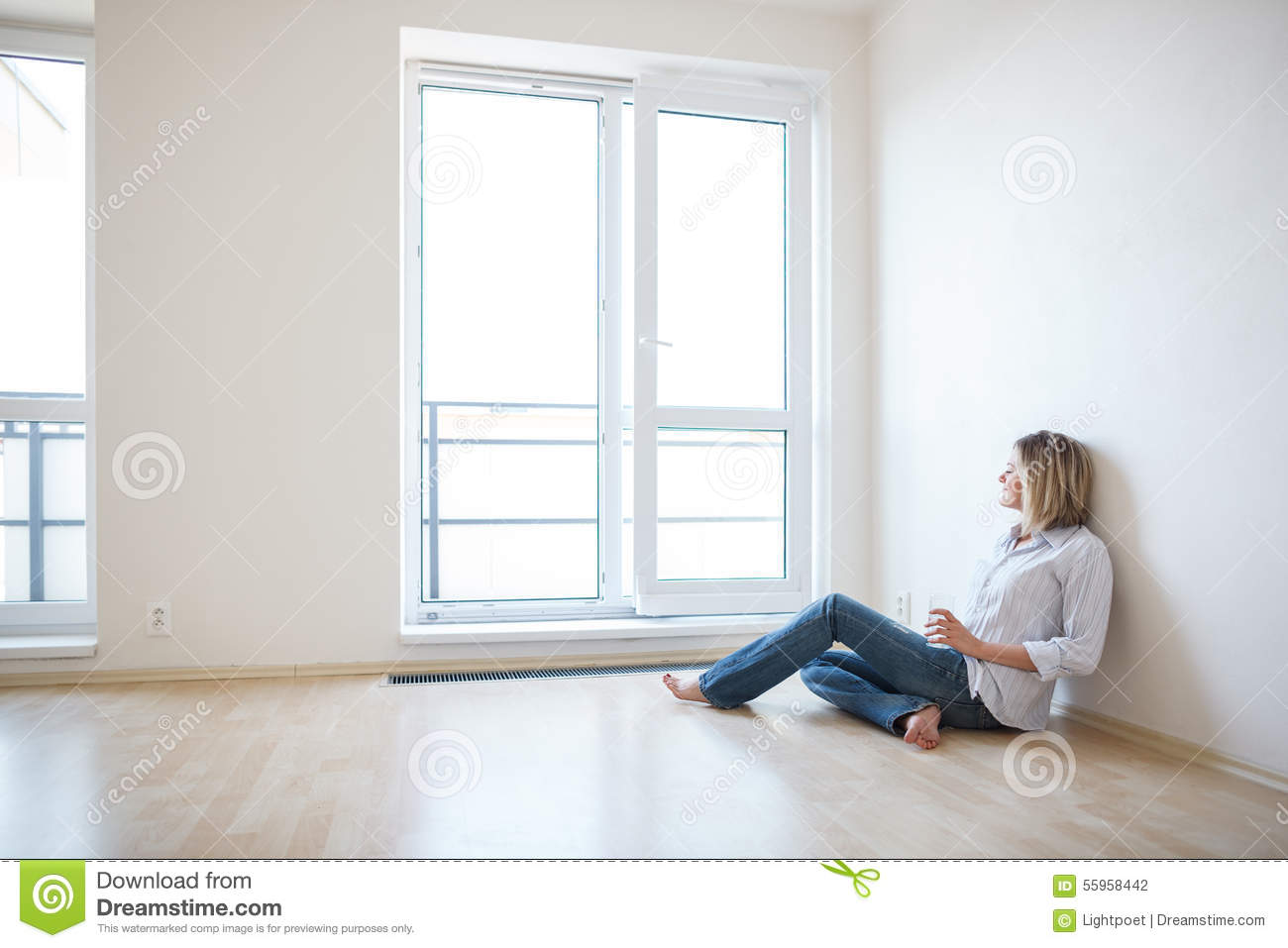Just moved in: beautiful young woman finally sitting down