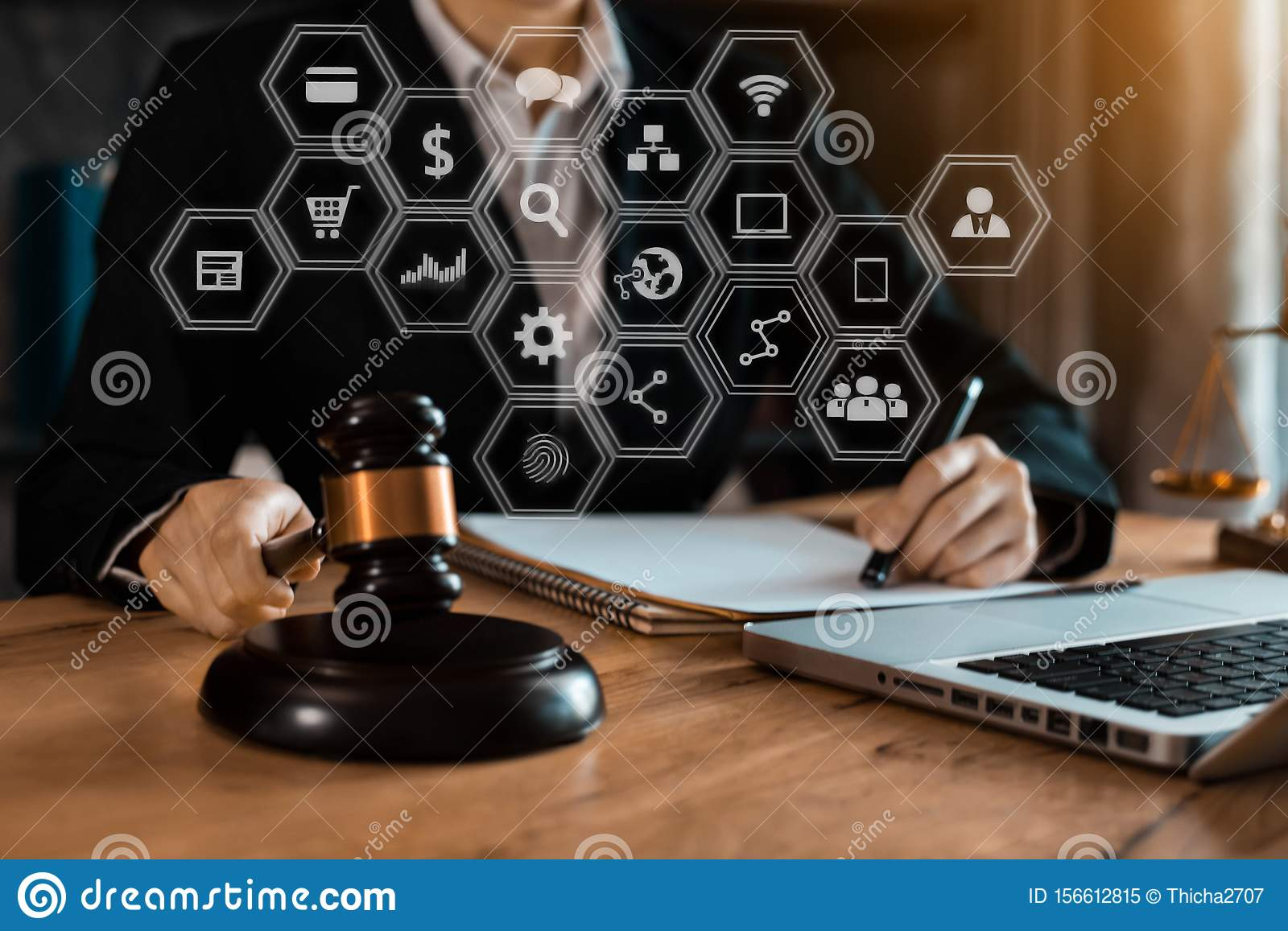 Justice and law concept. Female judge in a courtroom with the gavel working with digital tablet compute.