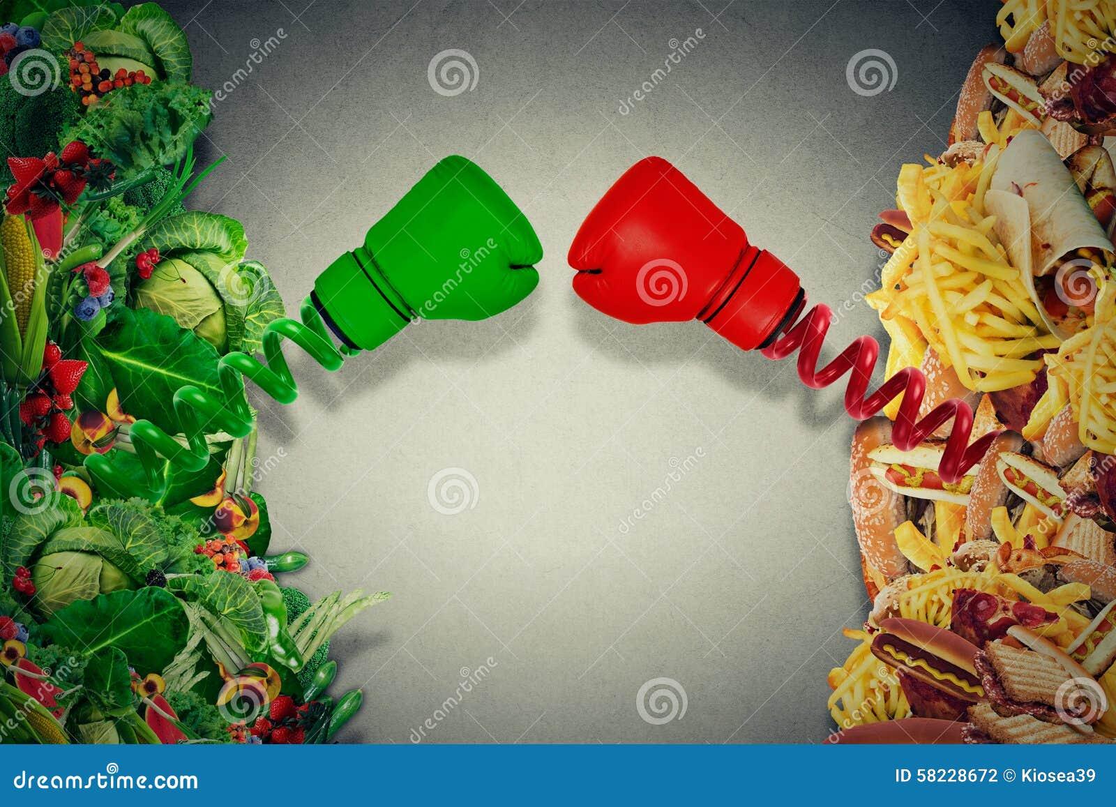 Kämpfende ungesunde Fertigkost des vegetarischen Lebensmittels mit den Boxhandschuhen, die e lochen