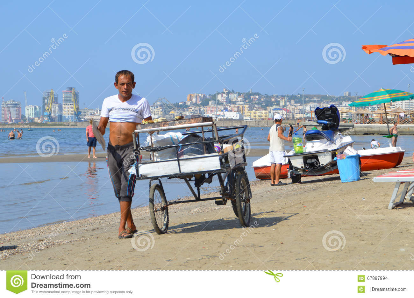 Köpmän på stranden av Durres