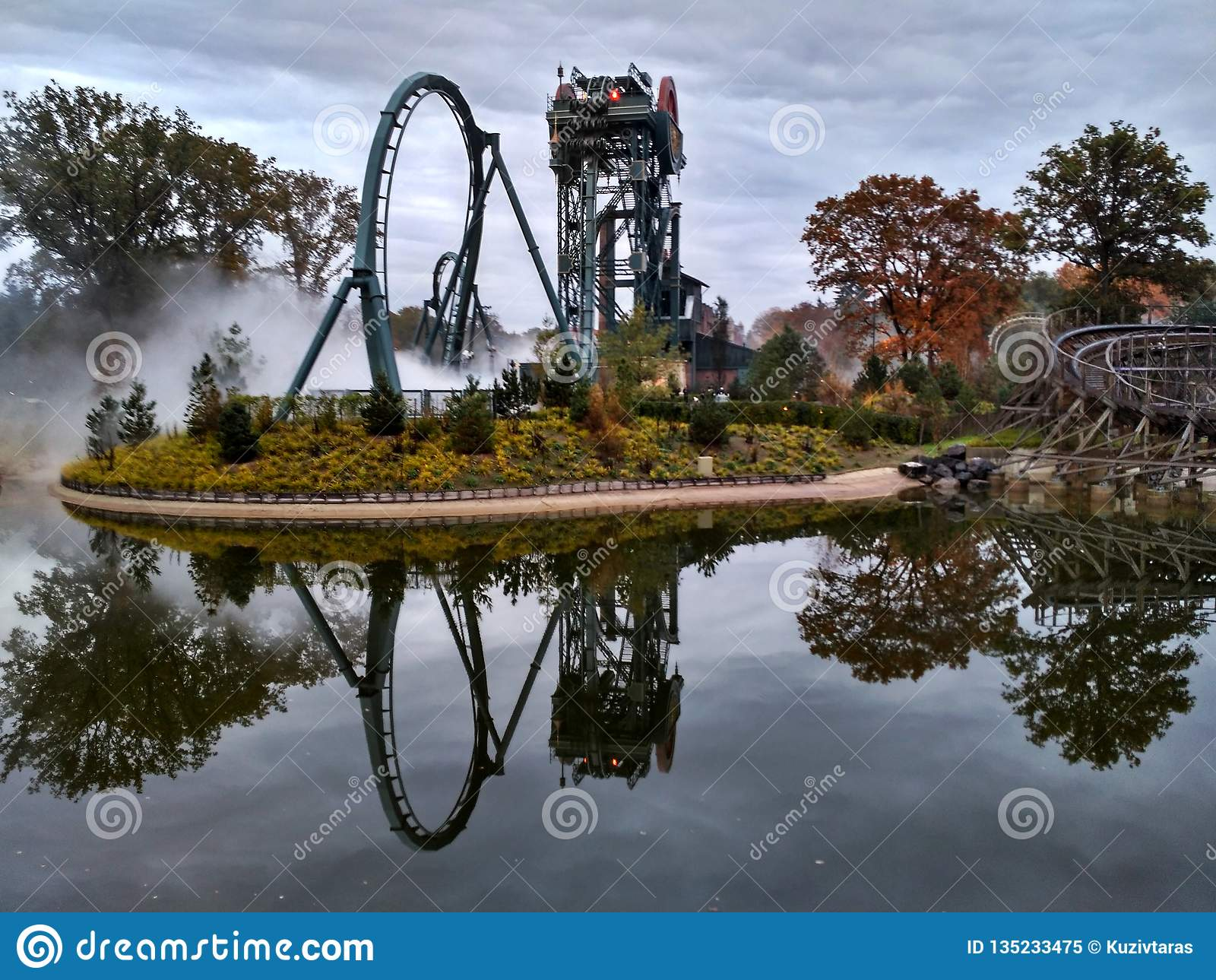 Kaatsheuvel / The Netherlands - November 03 2016: Speed roller coaster Baron 1898 in action in Theme Park Efteling. Symmetric