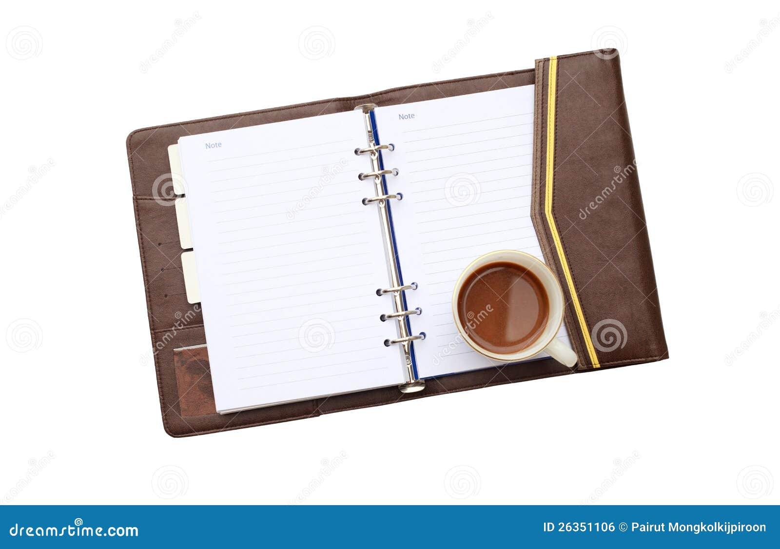 Kaffee mit Notizbuch