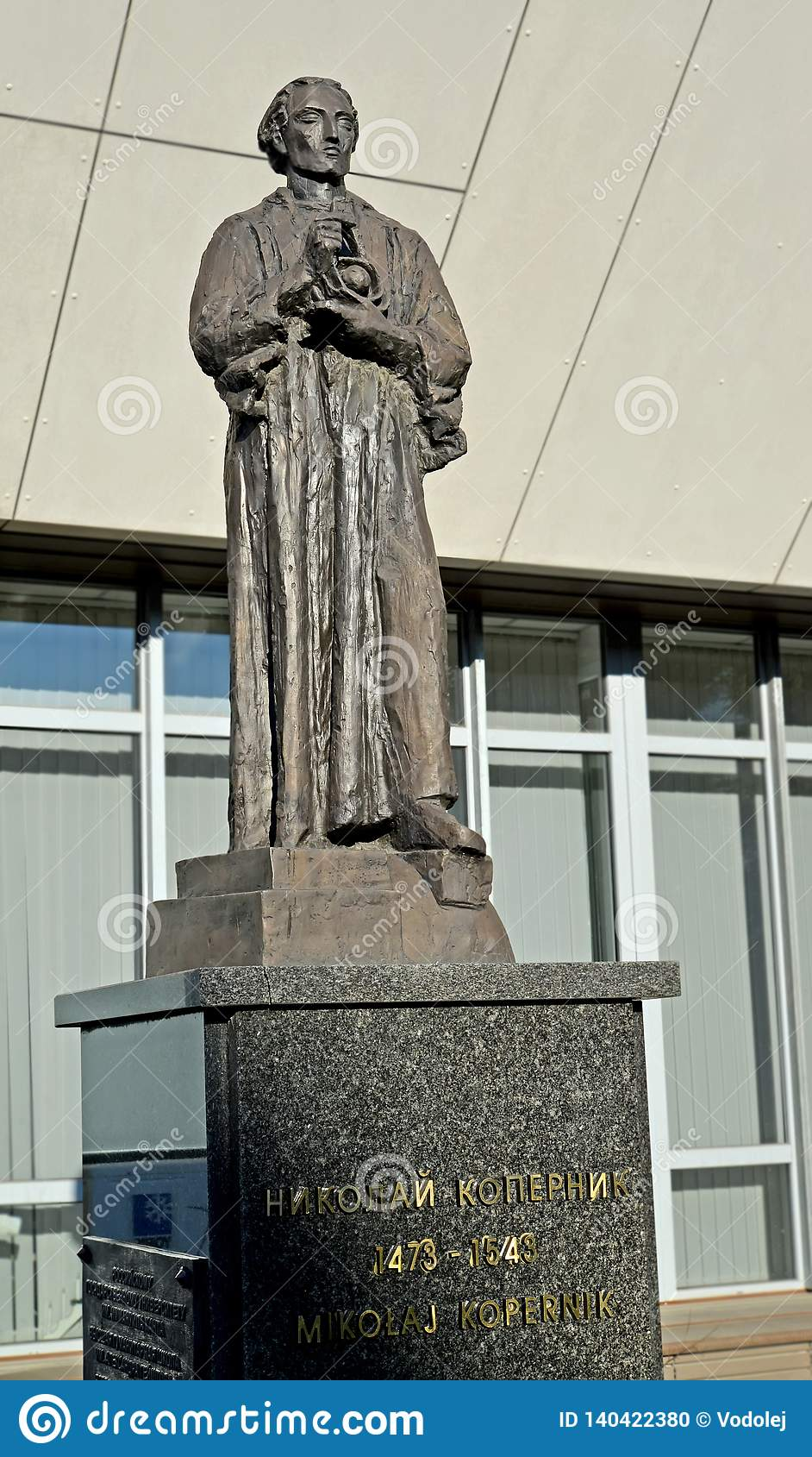 KALININGRAD, RUSSIA. Nicolaus Copernicus`s sculpture against the background of the university building. The Russian and Polish tex