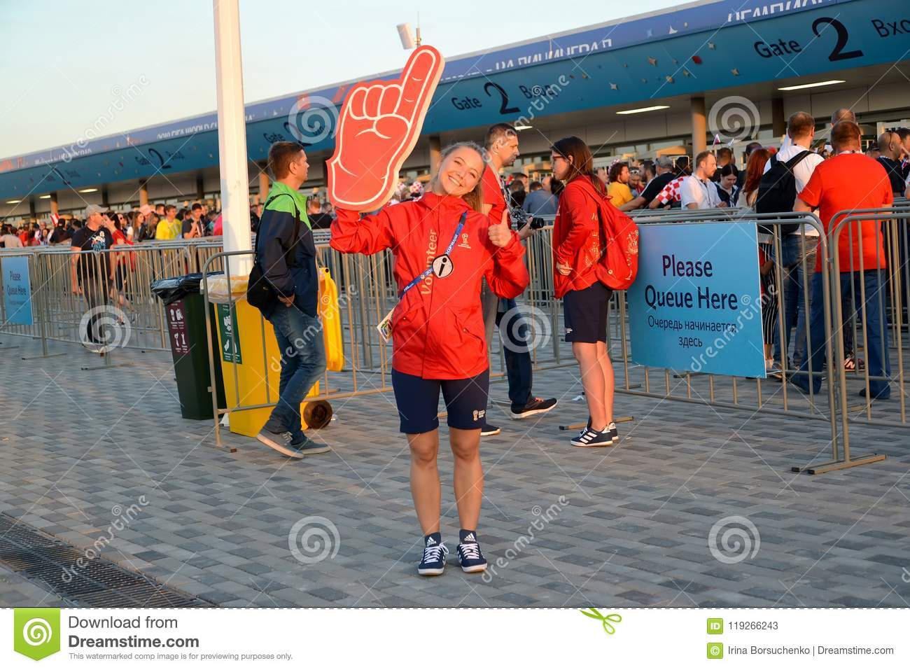 KALININGRAD, RUSSIA. The girl volunteer against the background of the entrance terminal of Baltic Arena stadium. The FIFA World Cu