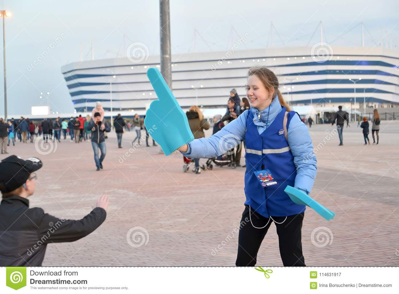 KALININGRAD, RUSSIA. The volunteer of the FIFA World Cup of 2018 with the index on a hand. Baltic Arena stadium