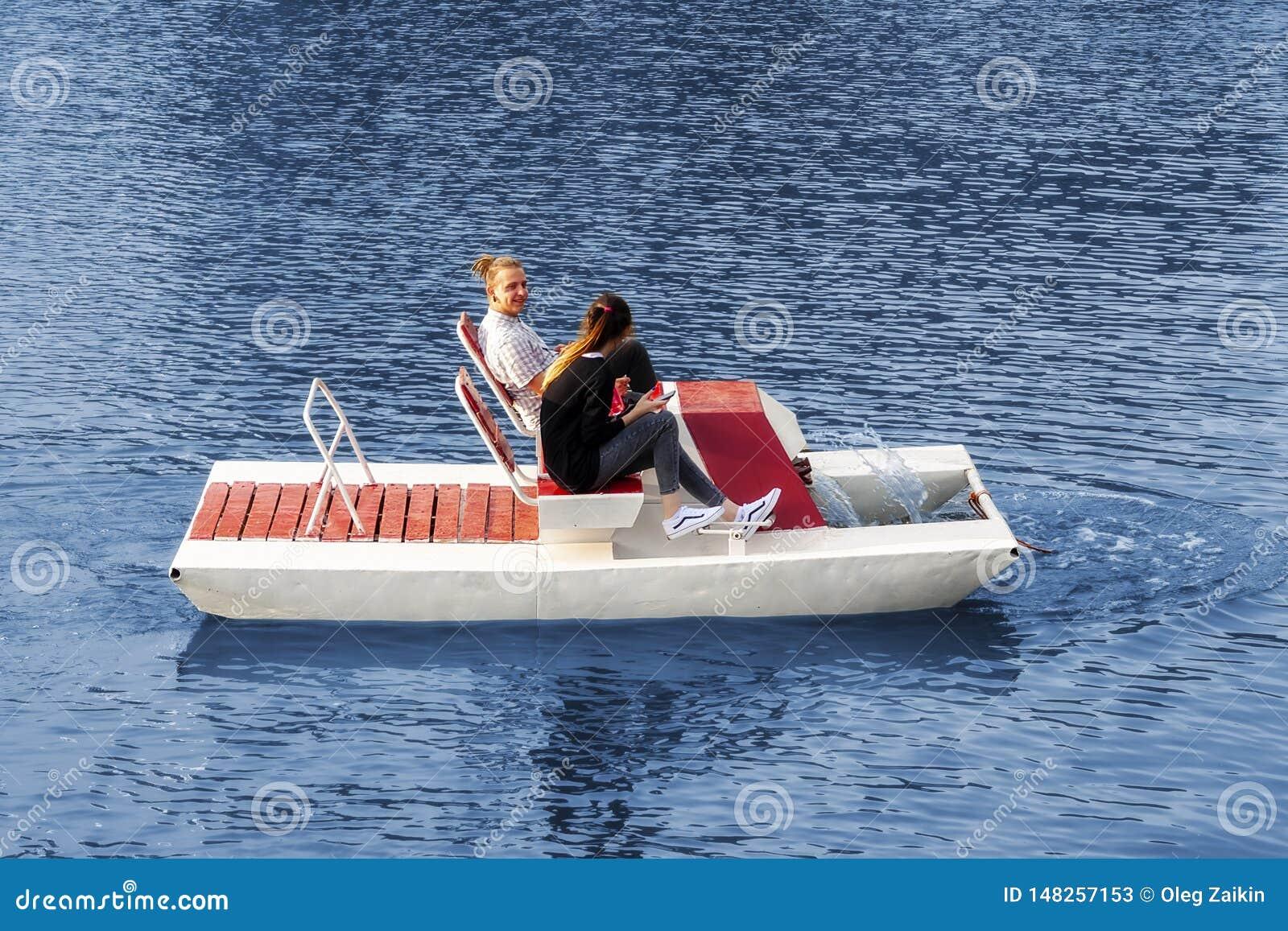 Kaliningrad Russia 05.01.2019 Young couple riding a catamaran