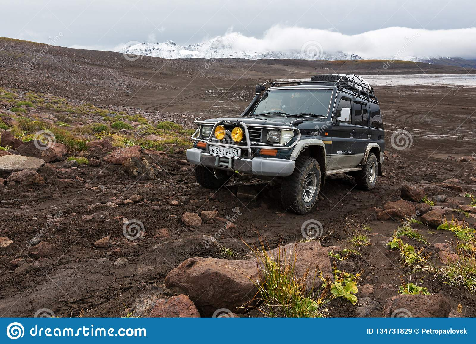 Off-road expedition auto Toyota Land Cruiser Prado driving on mountain road