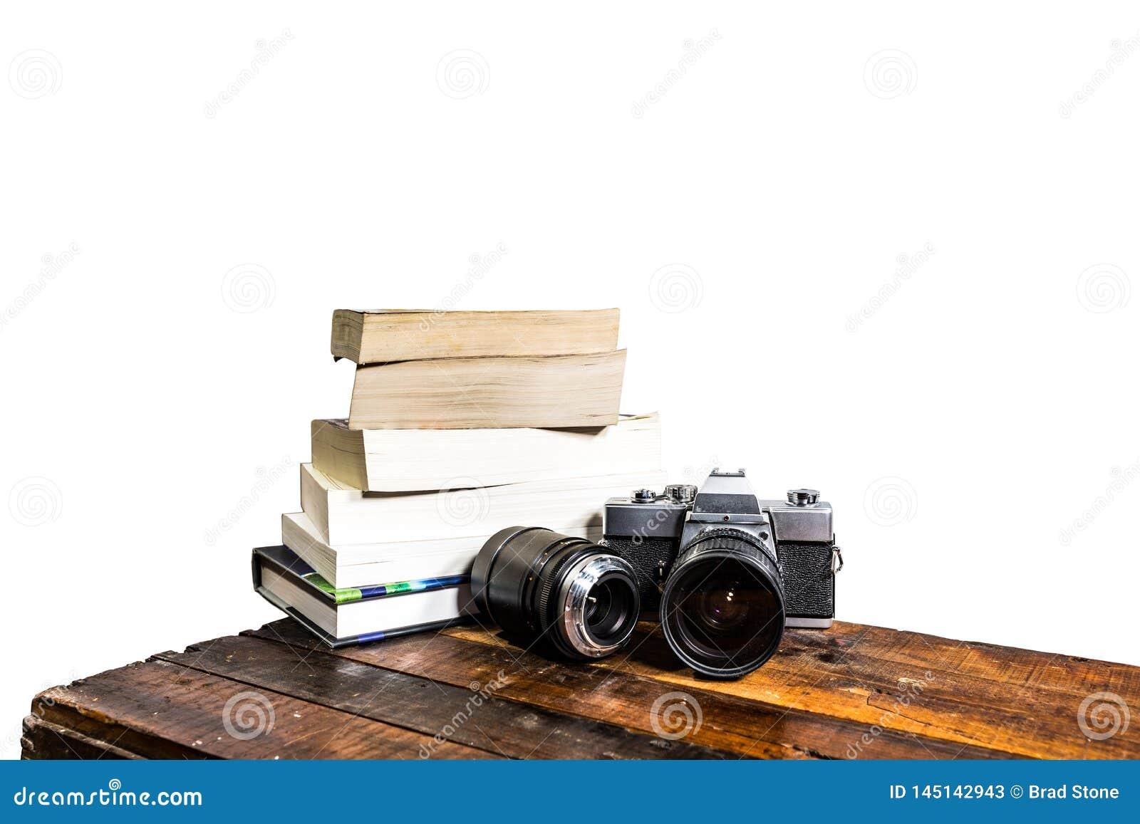 Kameran bokar träabstrakt begrepp på vit
