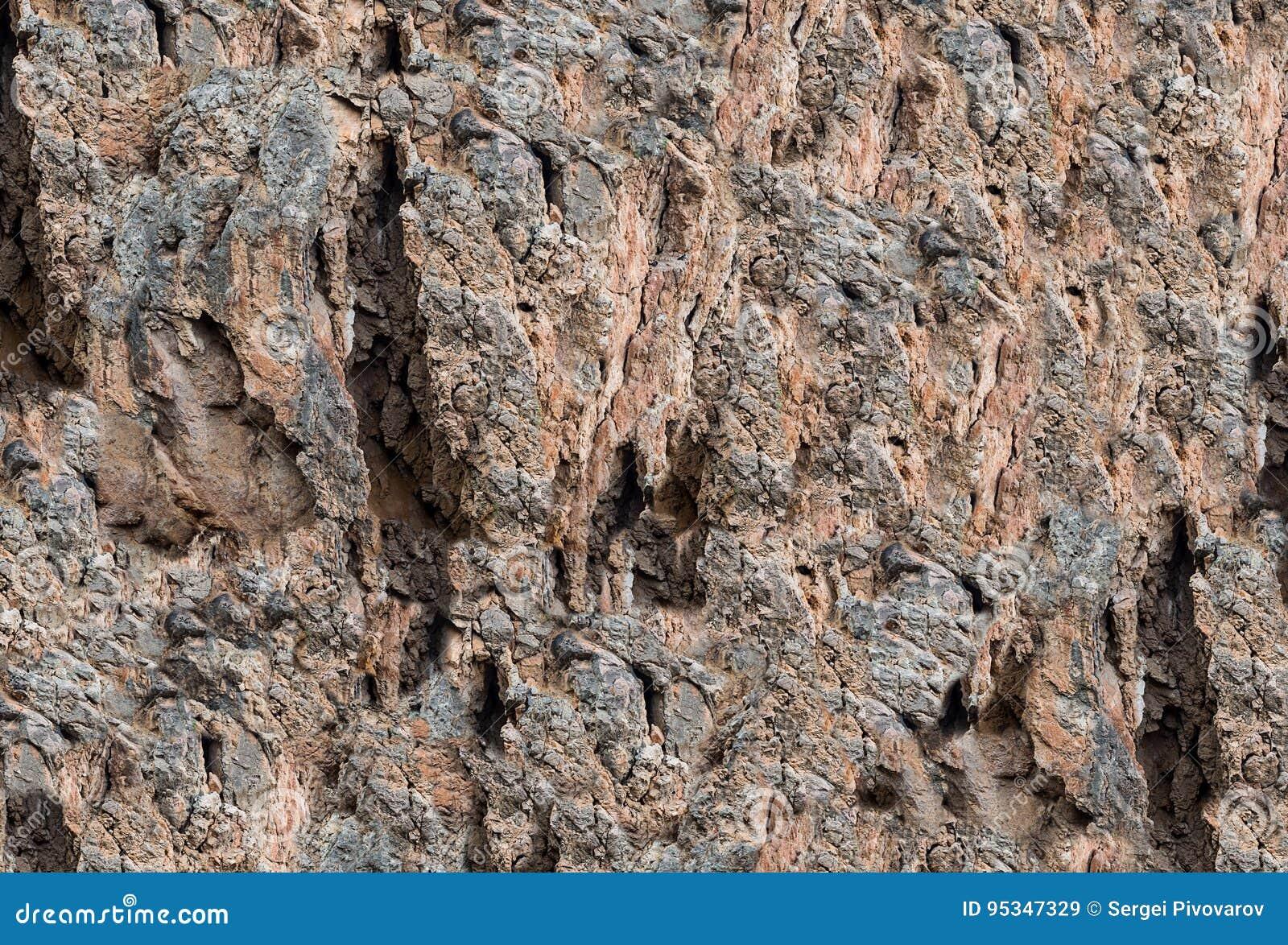 Kamienna tekstura z ogłoszonym wzorem rozpadliny i niegładkość