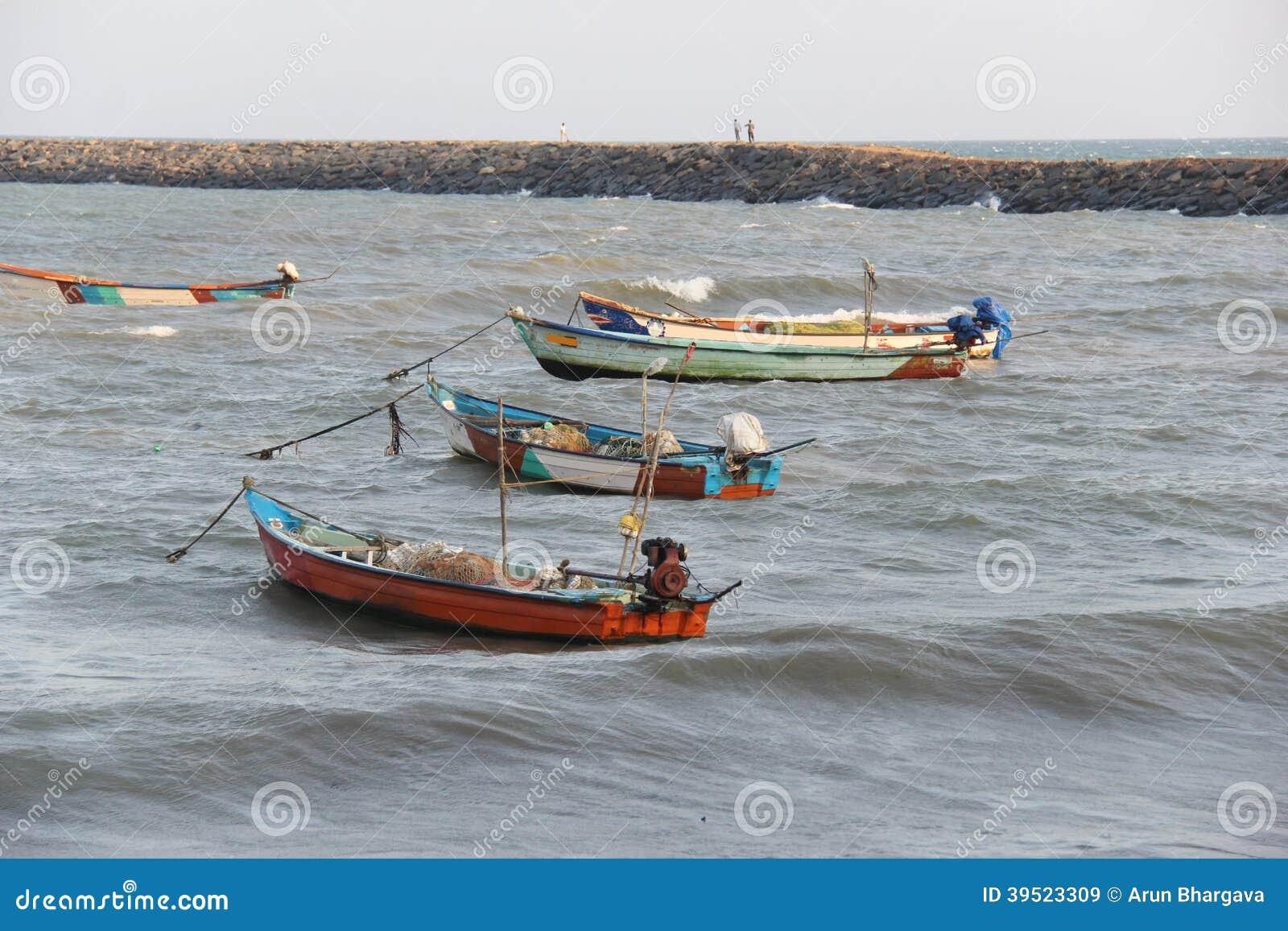 Kanyakumari fishing boats stock photo image 39523309 for Small fishing boats with motor