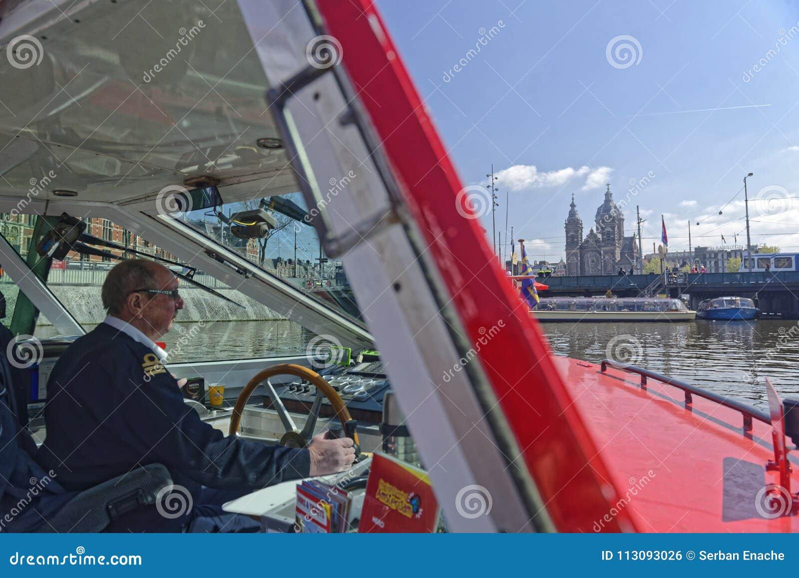 Kapitän des Besichtigungsbootes, Amsterdam, Holland