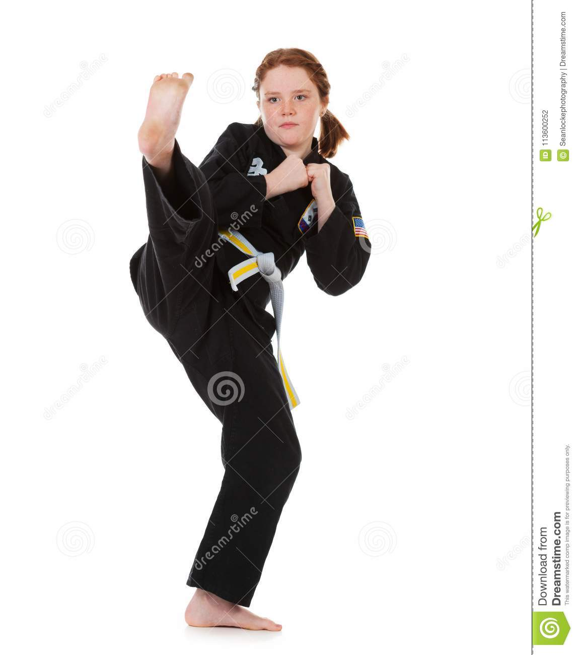 Karate: Confident Girl Does A Front Kick Stock Photo ...