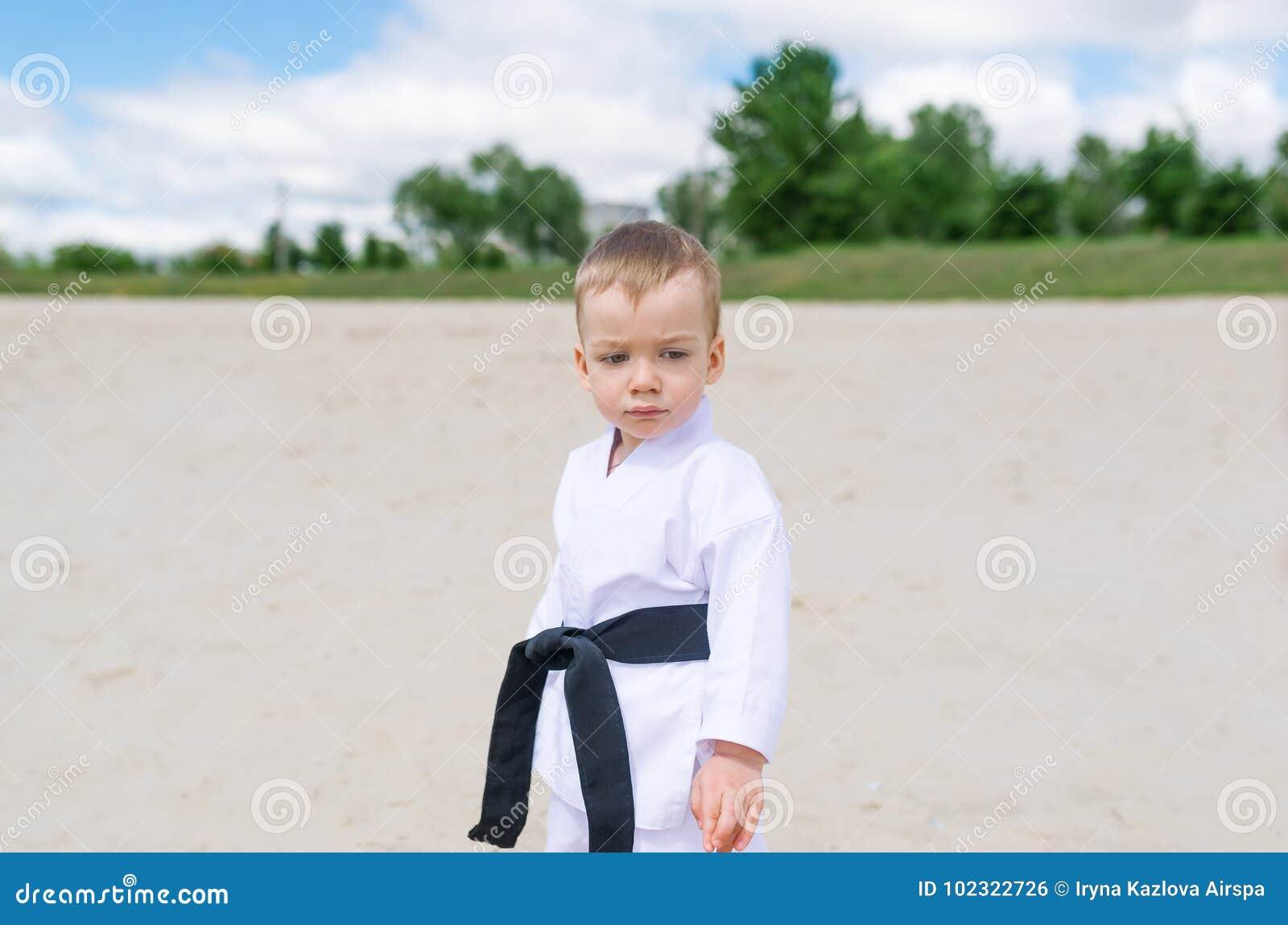 Karate kid - portrait of little boy in the kimono