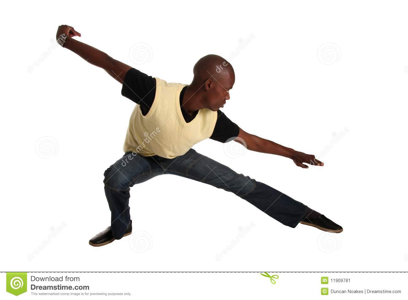 Good looking casual young African man in a karate pose.