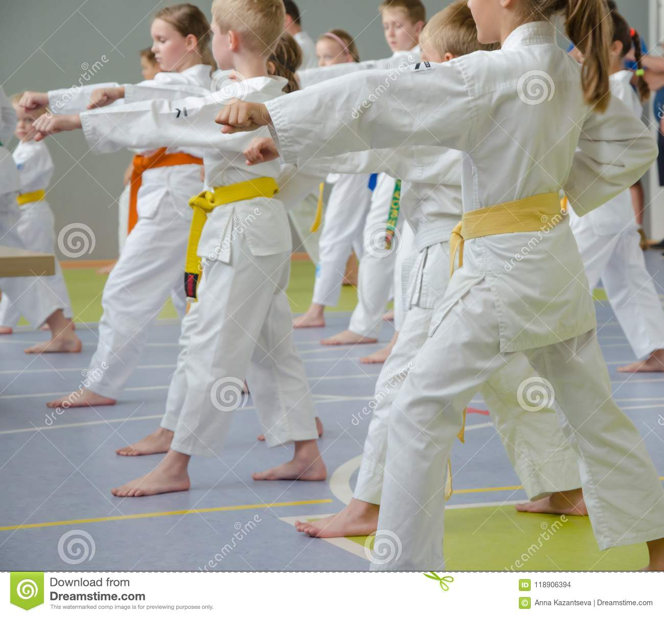 Karate training. Kids of different ages practice martial moves