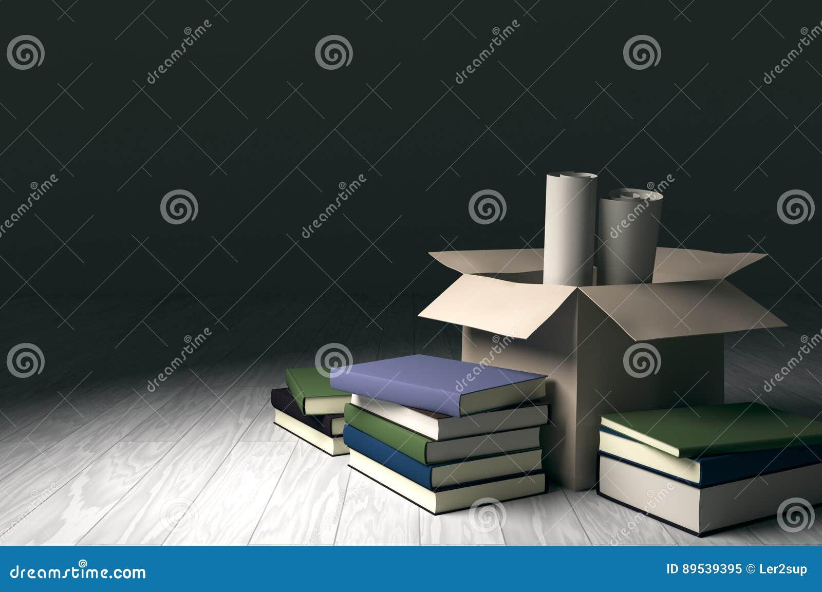 Karton z książkami i rolka papierami