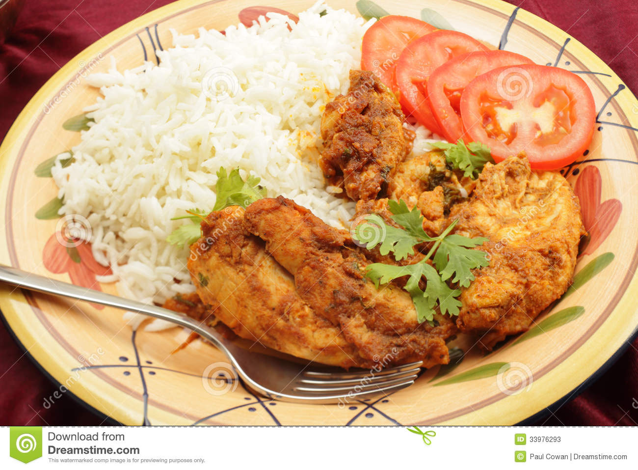 Kashmiri Chicken With Rice Tomato And Fork Stock Photos ...