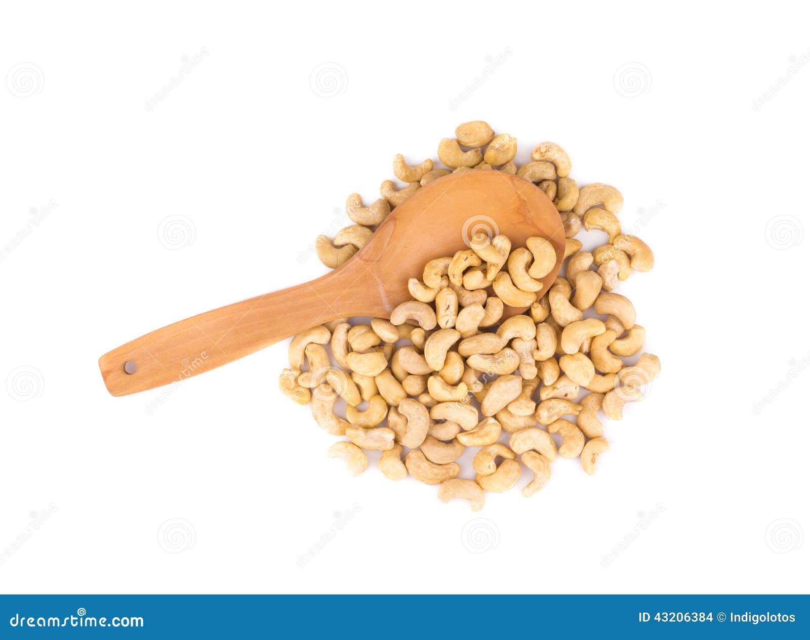 Download Kasjuer och träsked arkivfoto. Bild av näring, trä, cashew - 43206384