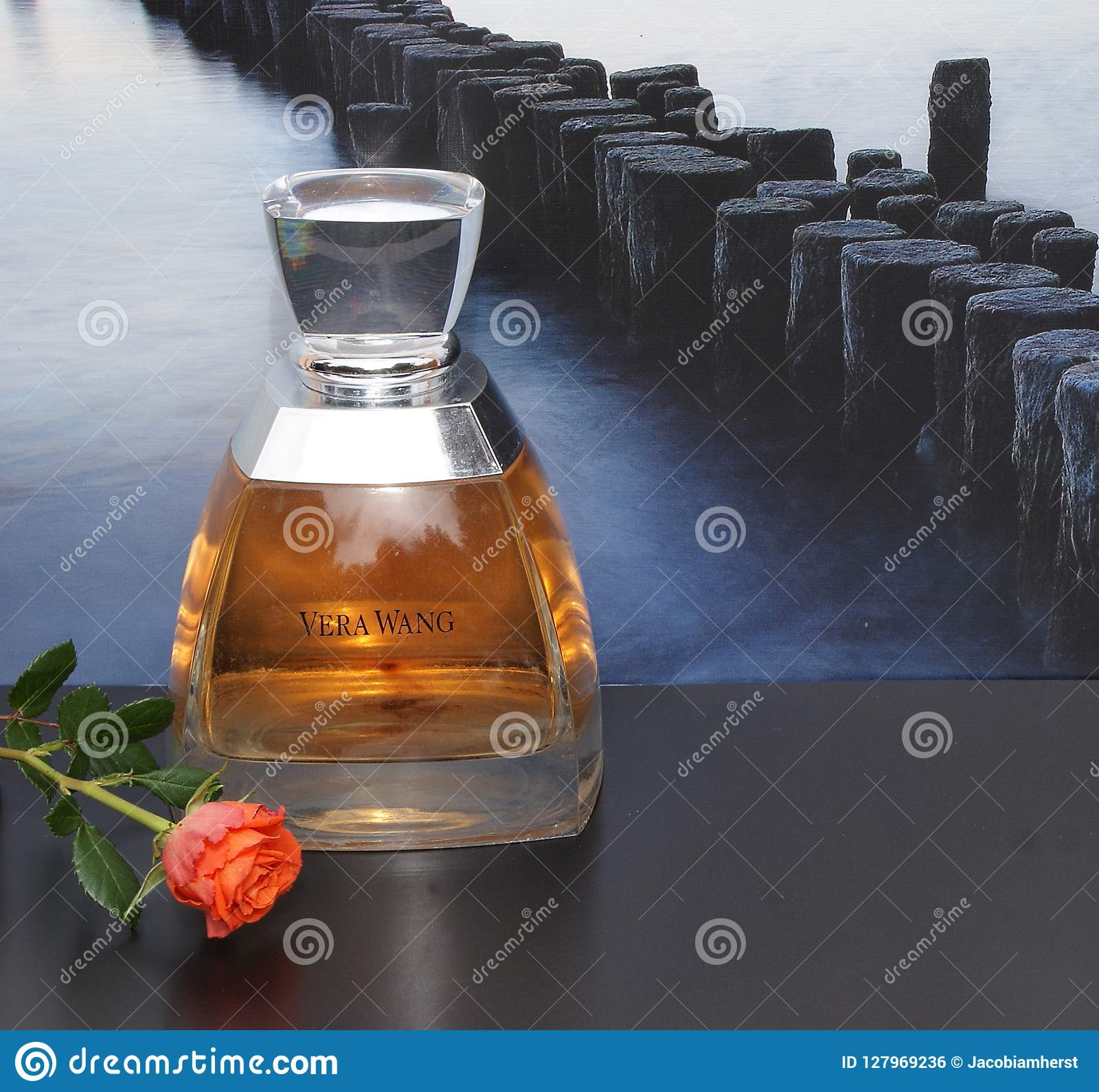 Vera Wang Fragrance For Ladies Large Perfume Bottle In Front Of The Picture Of A Groyne In The Sea Decorated With A Rose Editorial Photo Image Of Cosmetics Flacon 127969236