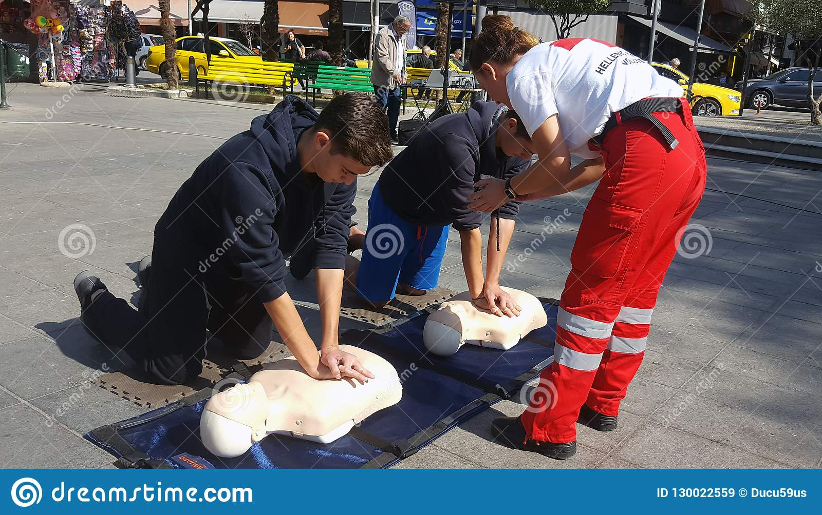 KATERINI, GREECE - OCTOBER 17 2018: The instructor of Red Cross showing CPR on training doll