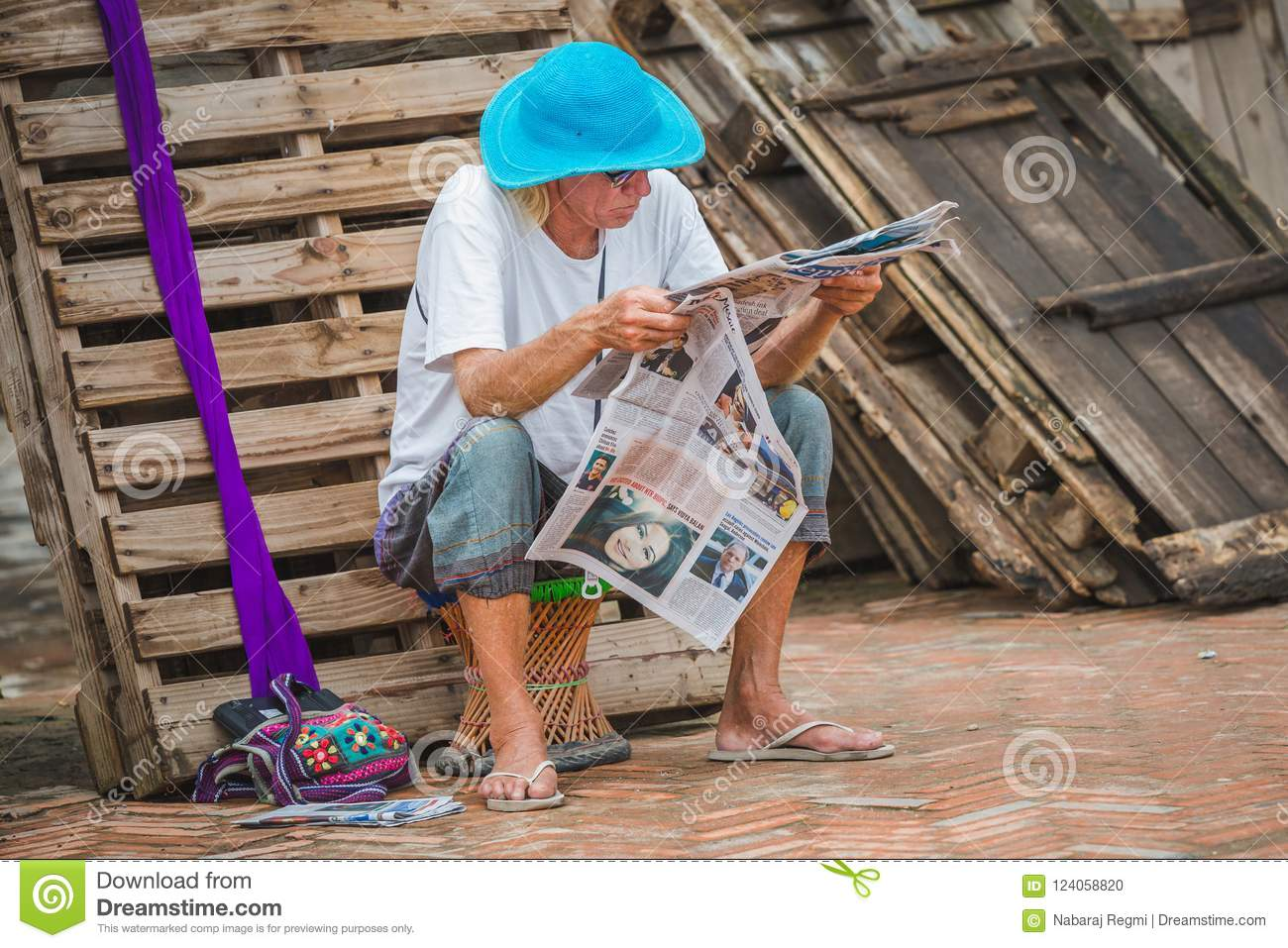 Foreigner Tourist Reading A Newspaper Editorial Image - Image of