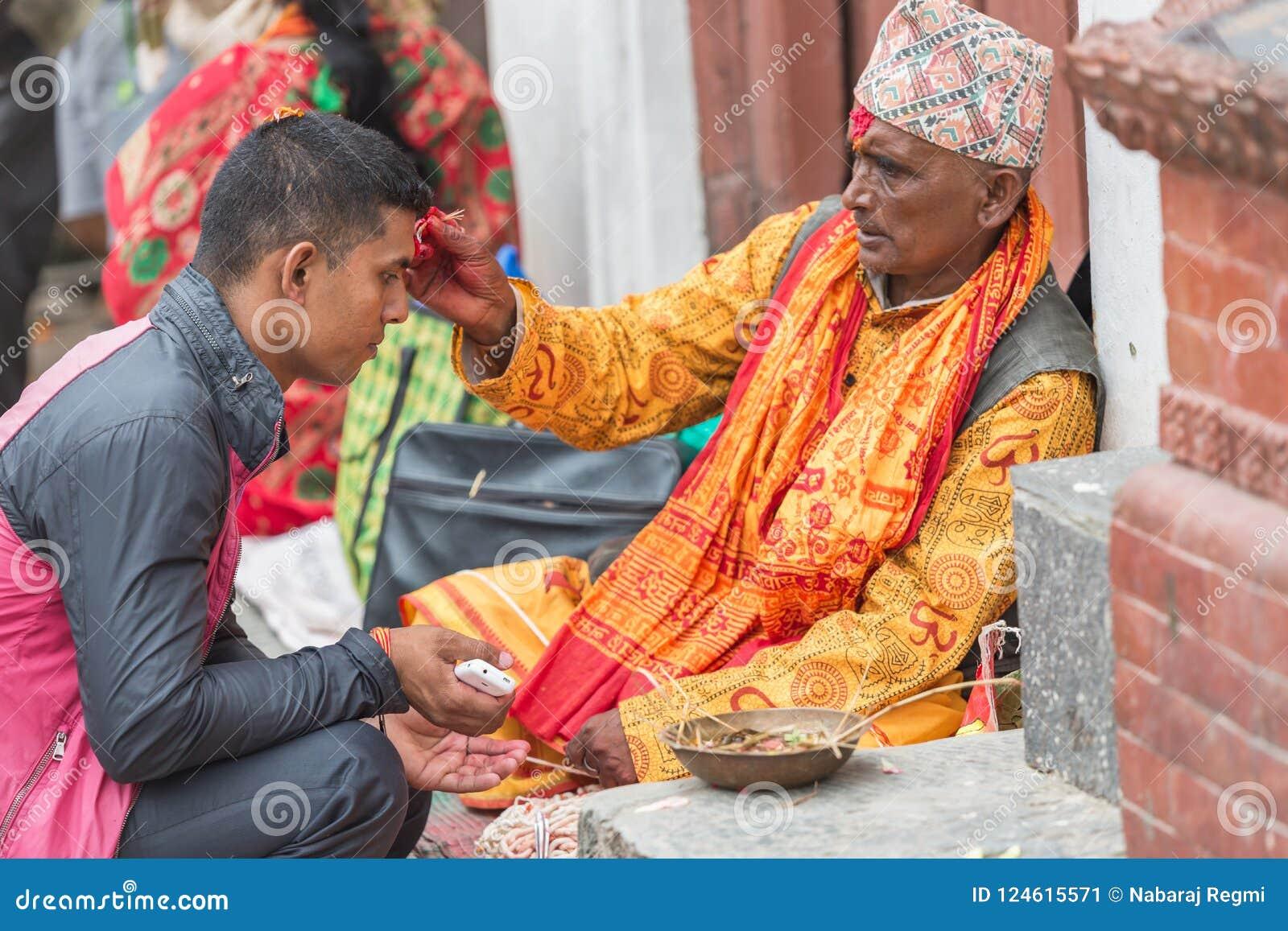 Hindu Pople Receiving Raksha Bandhan at Pashupatinath Temple in