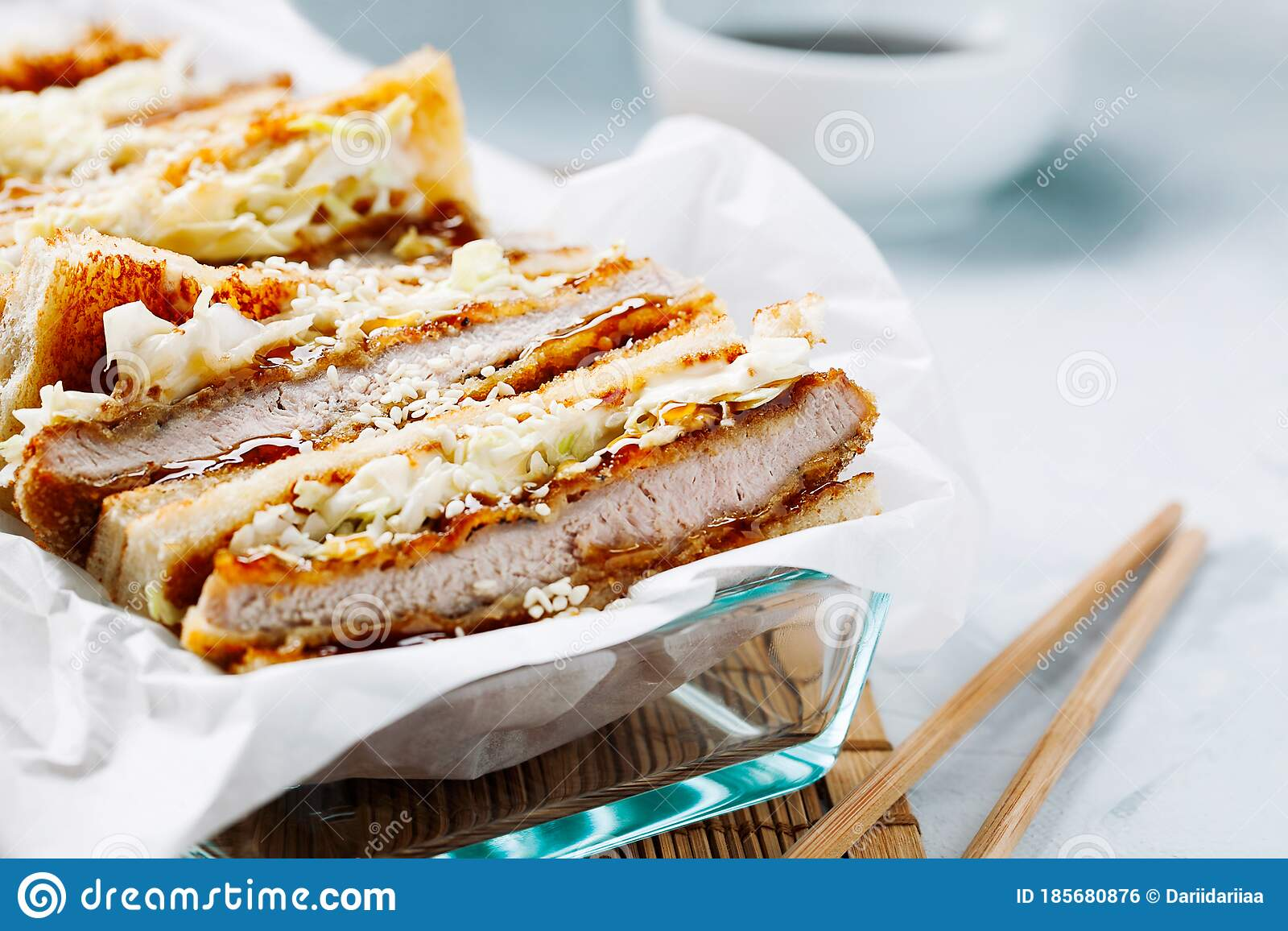 Katsu Sando Japanese Cutlet Sandwich With Deep Fried  Pork,cabbage,mayonnaise And Tonkatsu Sauce On A Light Background Stock  Photo - Image of chop, lunch: 185680876