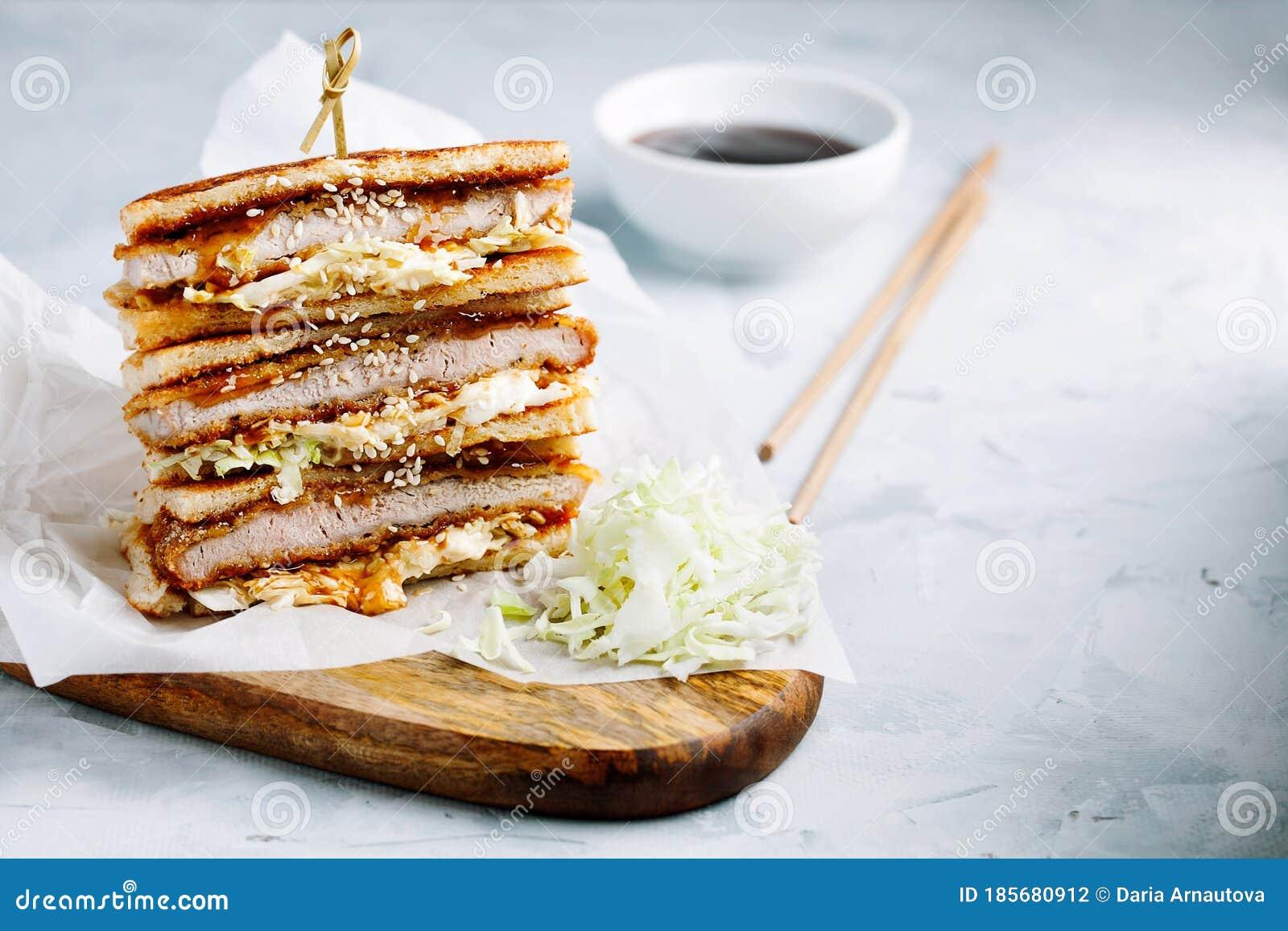 Katsu Sando Japanese Cutlet Sandwich With Deep Fried  Pork,cabbage,mayonnaise And Tonkatsu Sauce On A Light Background Stock  Photo - Image of cuisine, katsu: 185680912