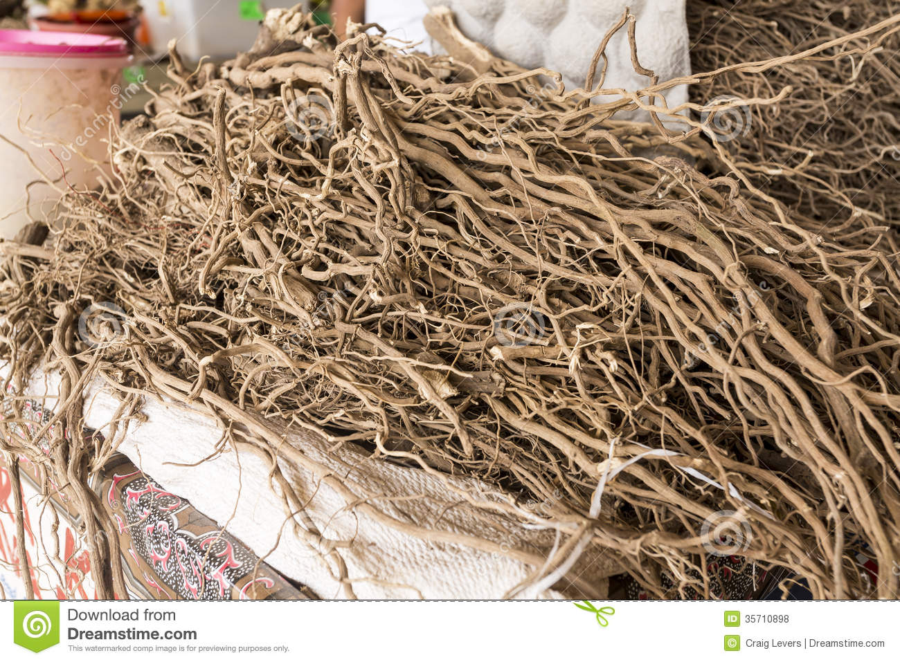 Freshly harvested and dried Kava root in a Fijian farmers' market.