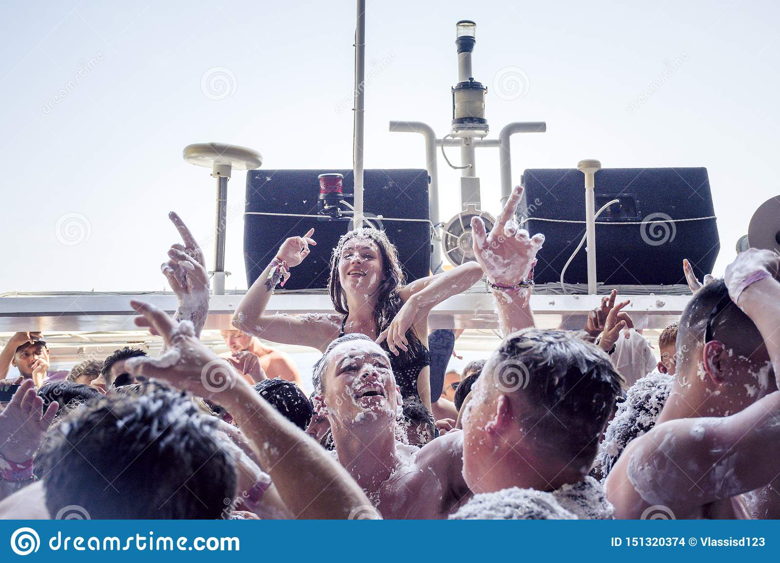 KAVOS,CORFU/GREECE-JUNE 22 2019:Young British holiday makers partying on one of the many ,so called ,booze cruise.
