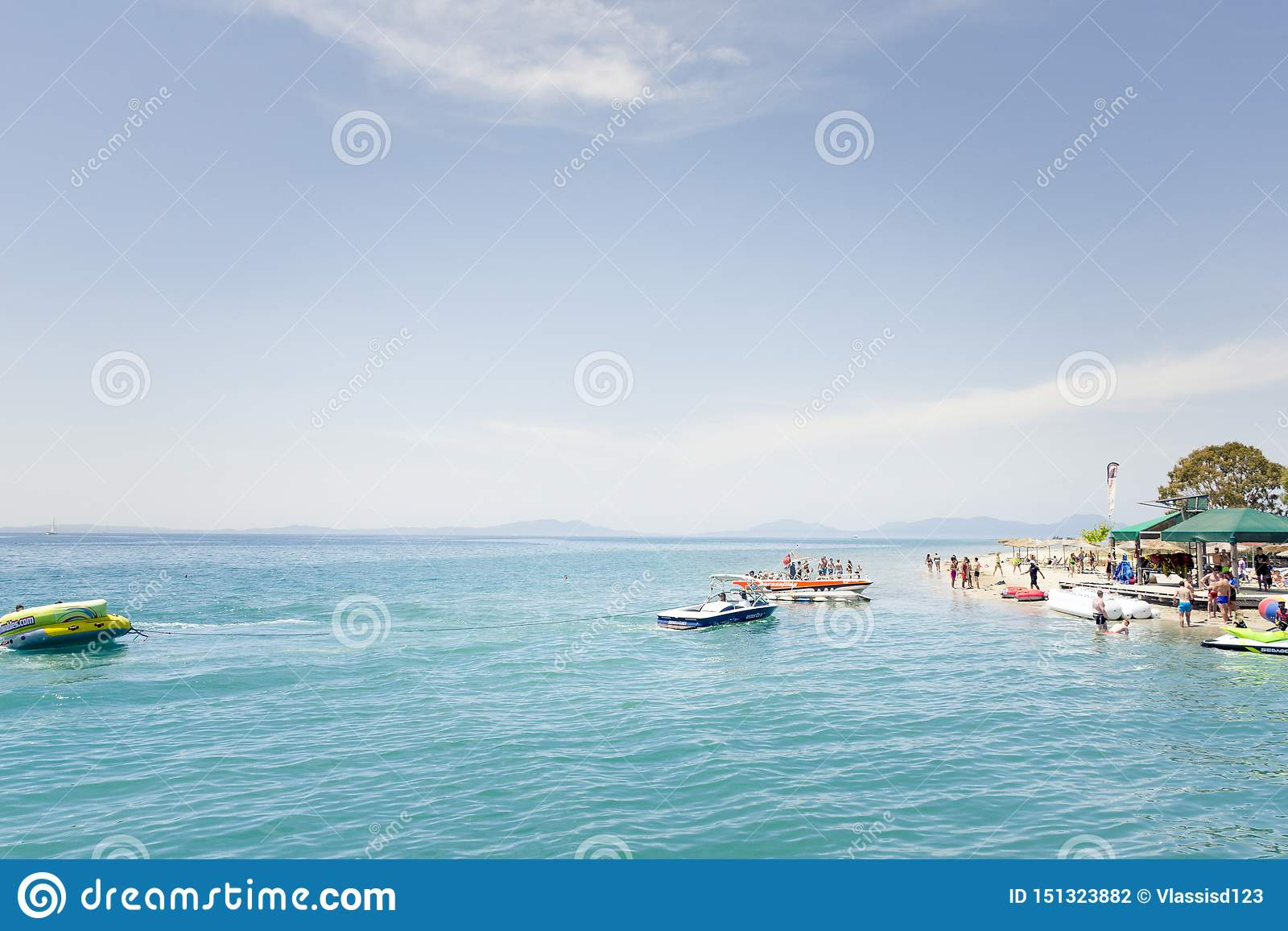KAVOS,CORFU/GREECE-JUNE 22 2019:Young British holiday makers partying on one of the many ,so called ,booze cruise