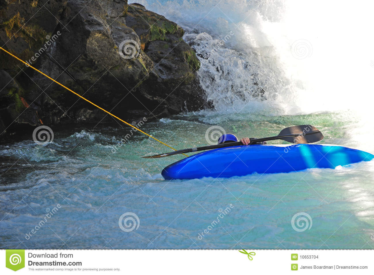 Kayaker being pulled to safety