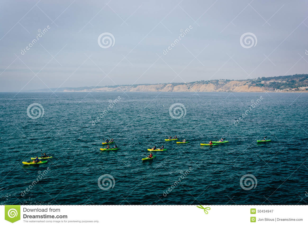 Kayakers in the Pacific Ocean, seen from La Jolla, California.