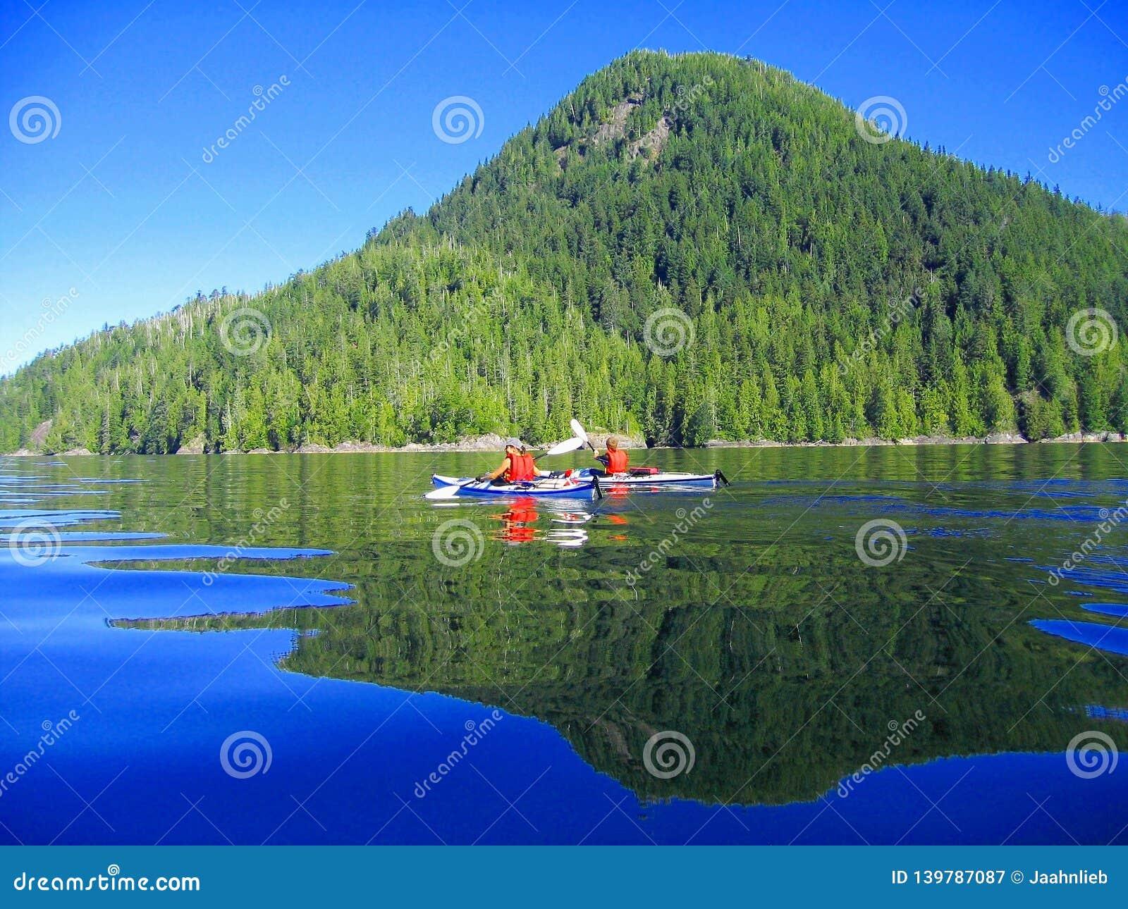 Kayaking in Calm Waters at McKay Island, Clayoquot Sound north of Tofino, British Columbia