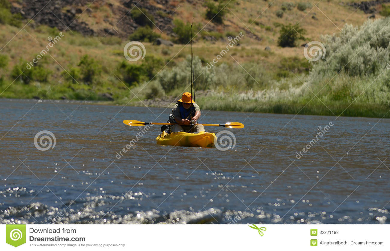 Royalty free stock photos kayaking in river with fishing for Free fishing stuff