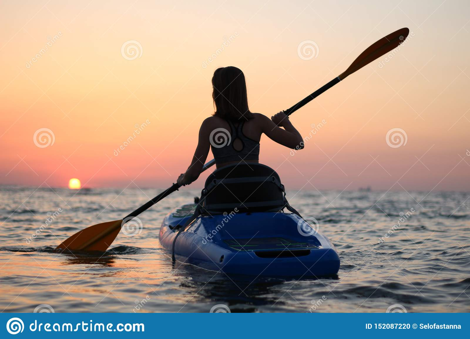 Kayaking Woman in kayak, Girl Rowing in the water of a calm sea