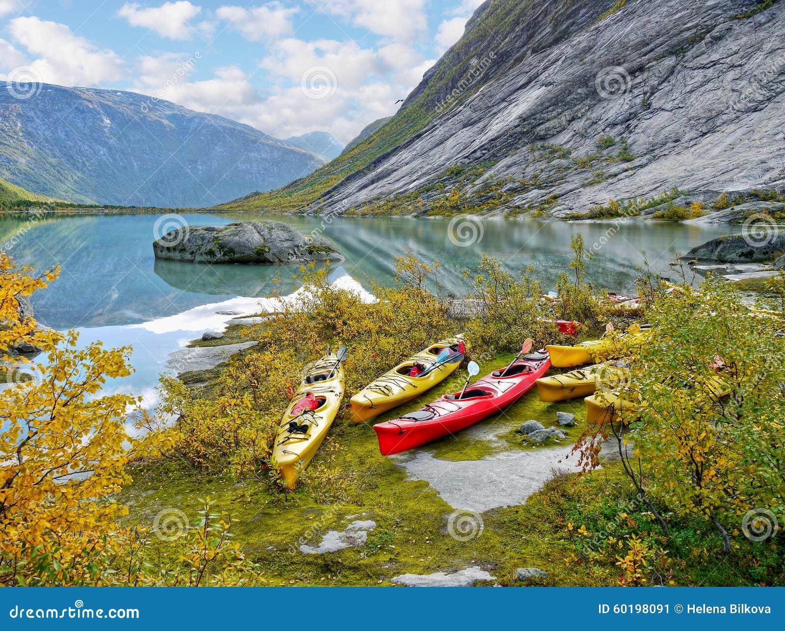 Kayaks at glacier lake, Autumn