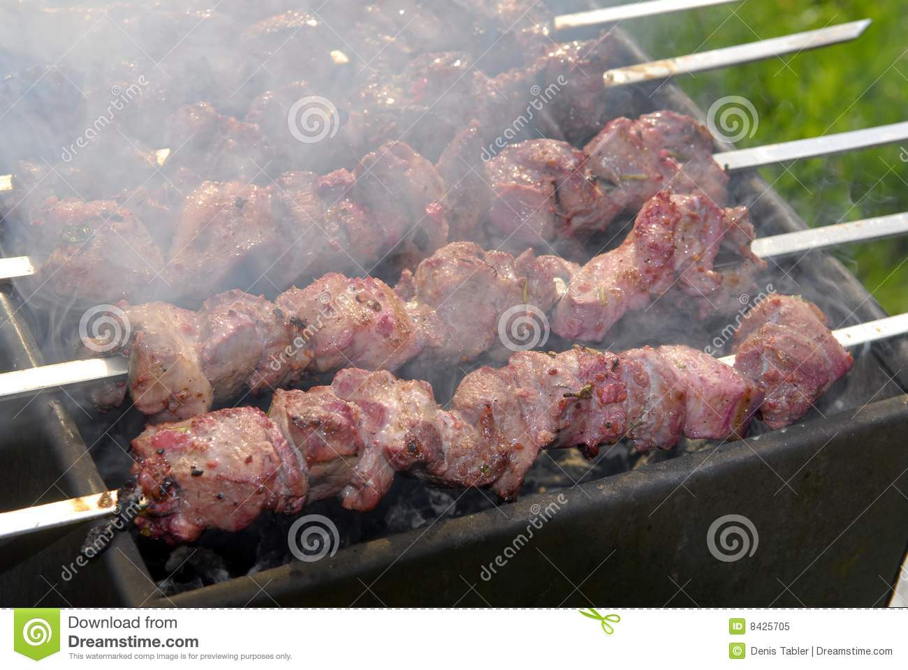 Kebabs cooking on brazier