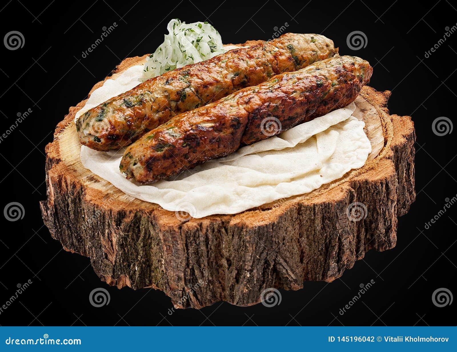 Kebab of chicken on a wooden slice