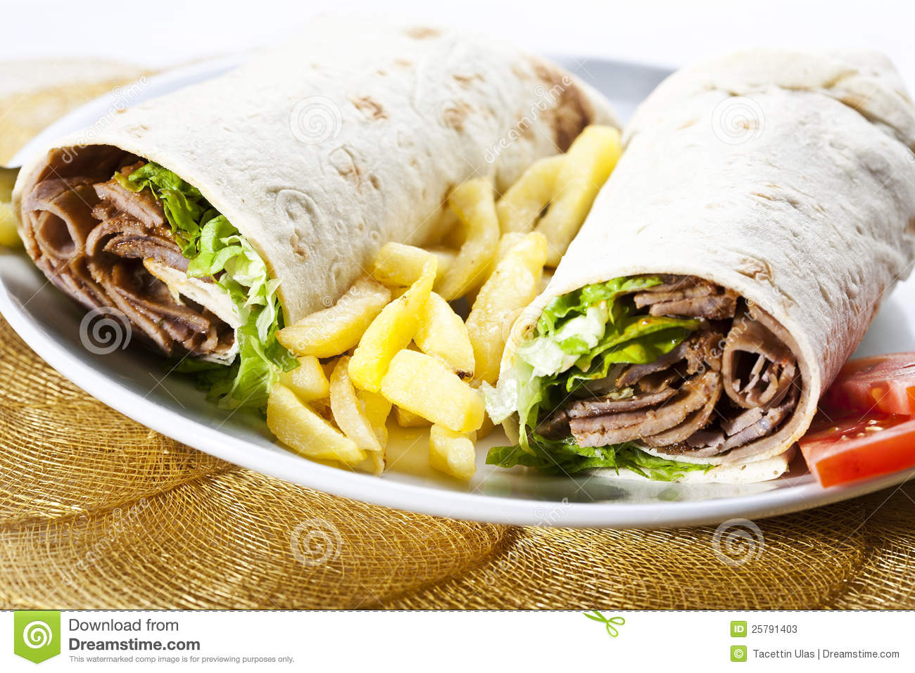 Kebab wrap, Turkish traditional food with french fries and vegetable.