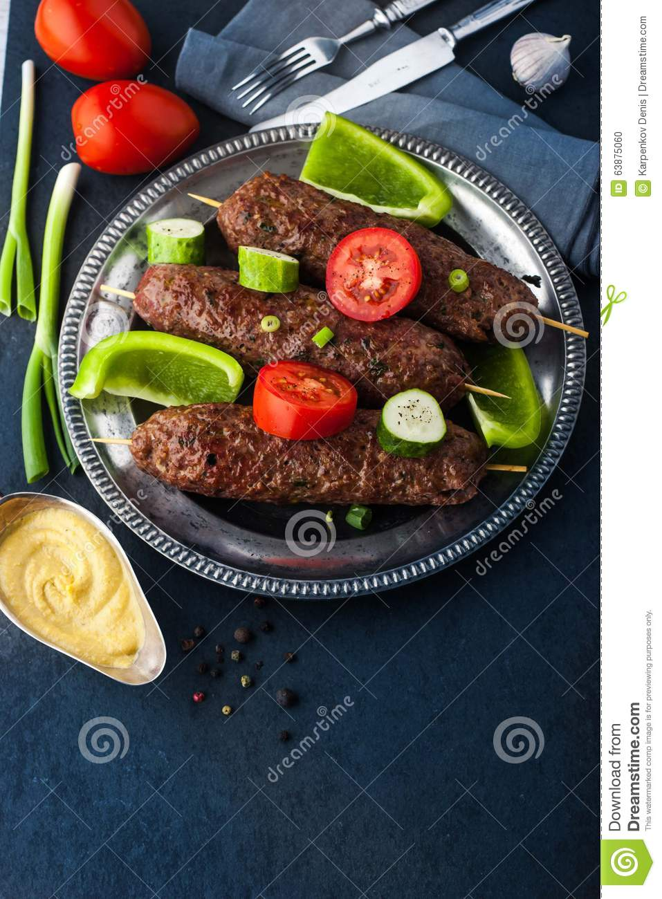 Kebabs With Vegetables On The Vintage Metal Plate Vertical ...