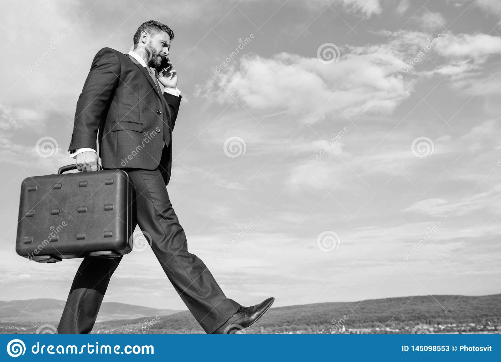 Keep going towards your goal. Businessman formal suit carries briefcase sky background. Businessman solving business