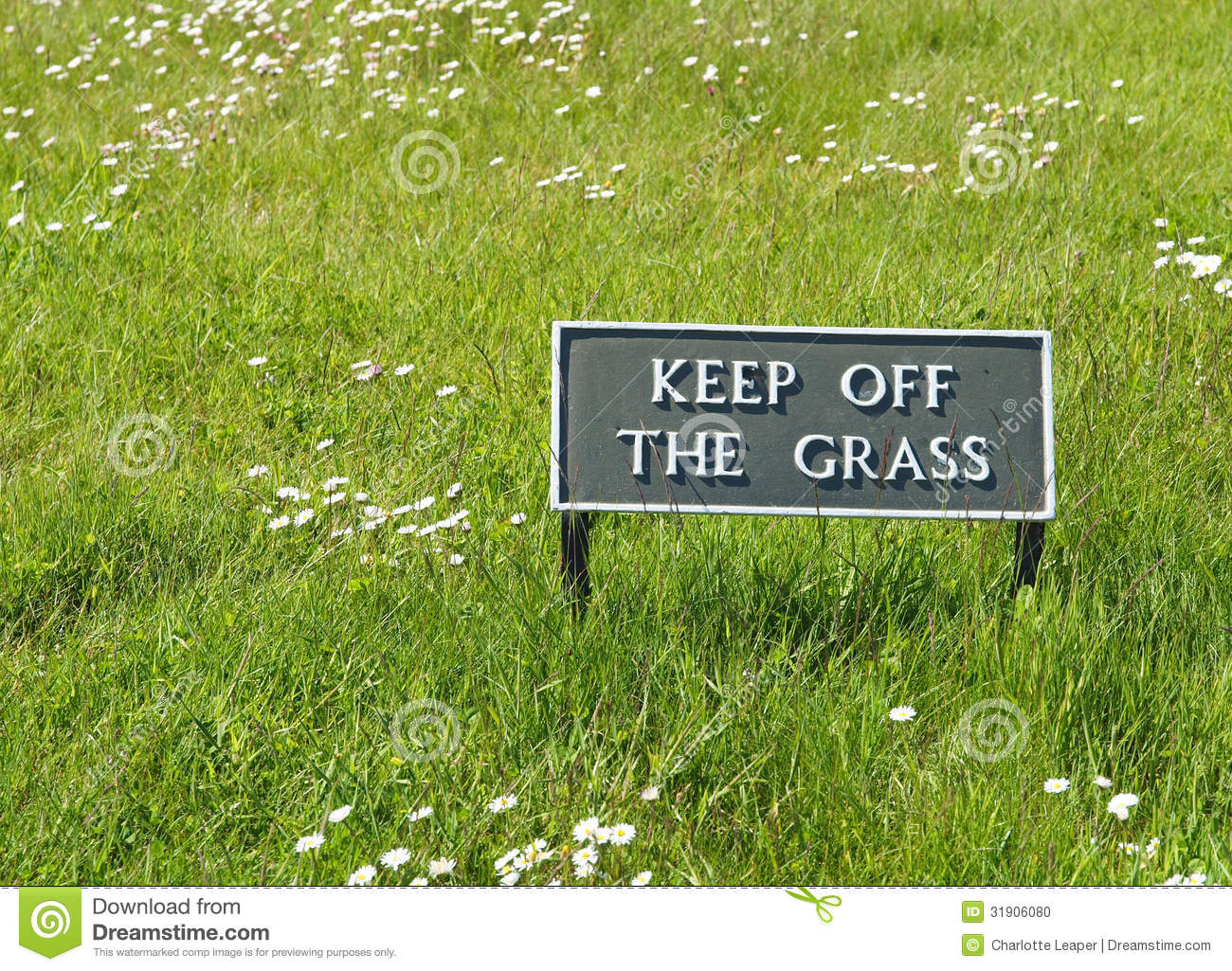 keep off the grass sign stock photo