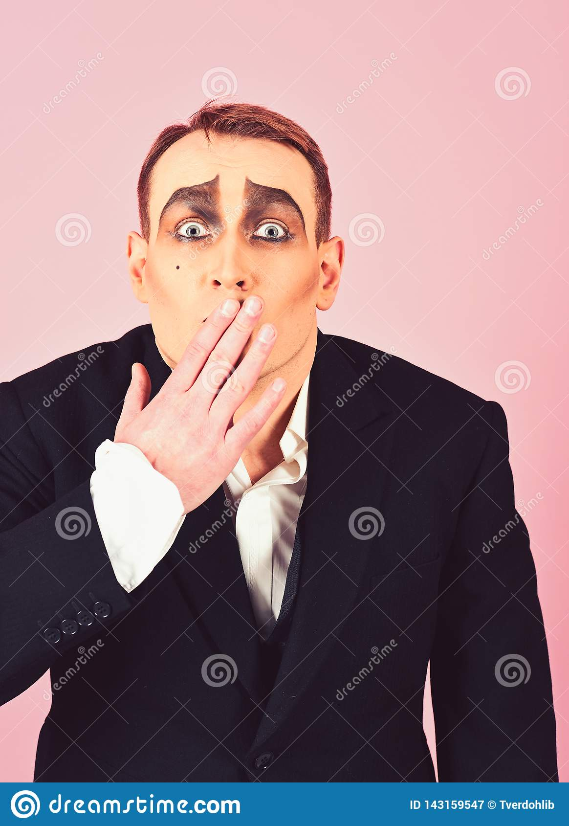 Keeping secret. Mime artist cover mouth with hand. Mime with face paint. Man actor with mime makeup. Theatre actor